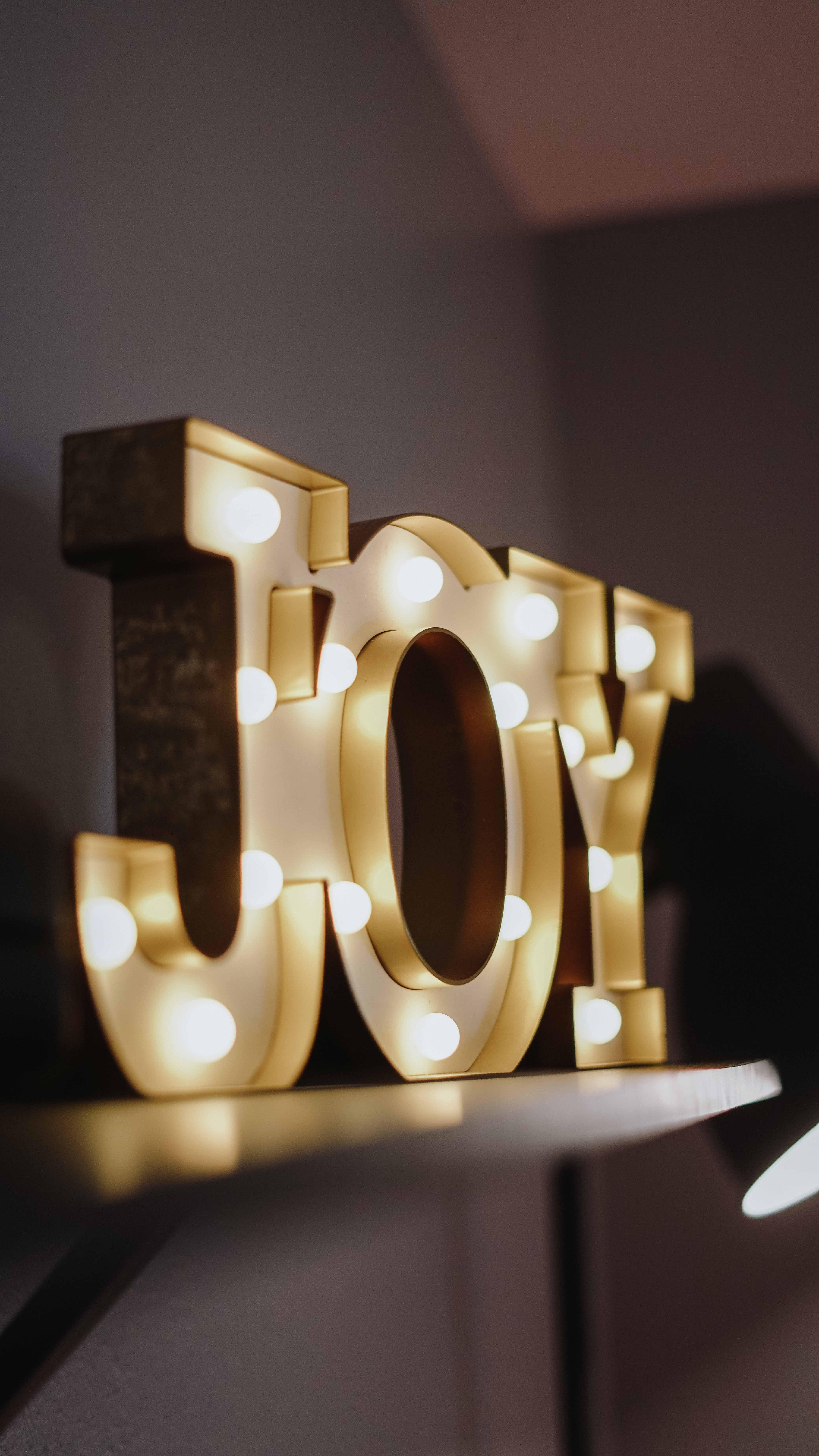 free photo selective focus photography of joy free standing letters