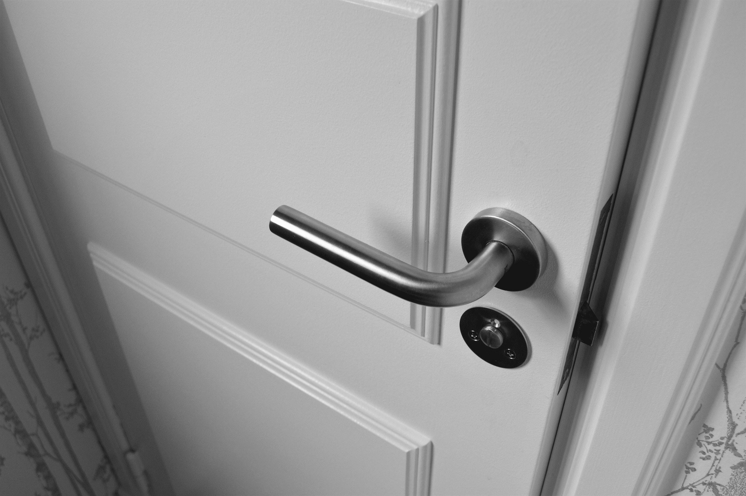 Semi open white wooden door photo