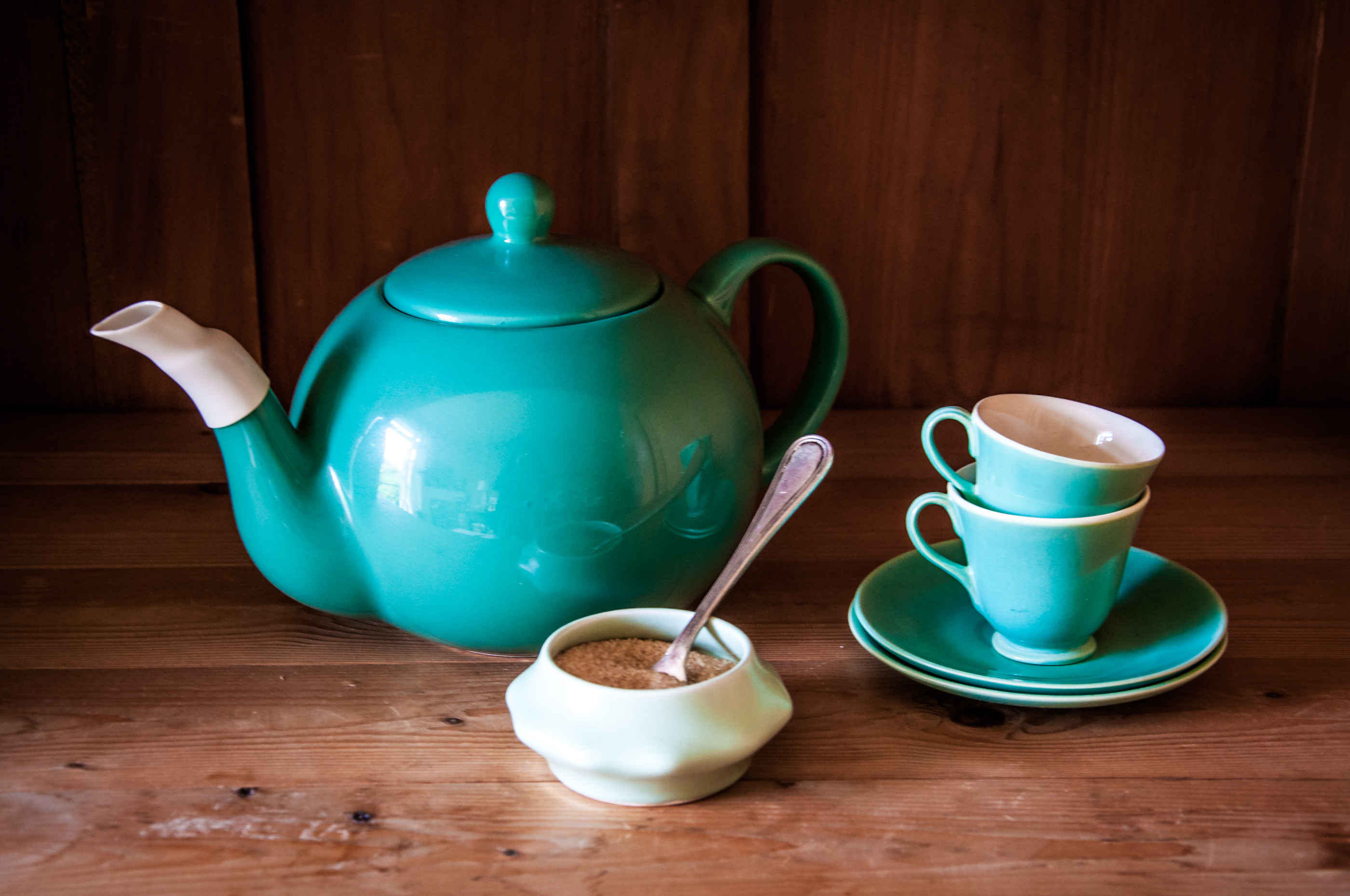 Set turquoise cups, sugar and teapot photo