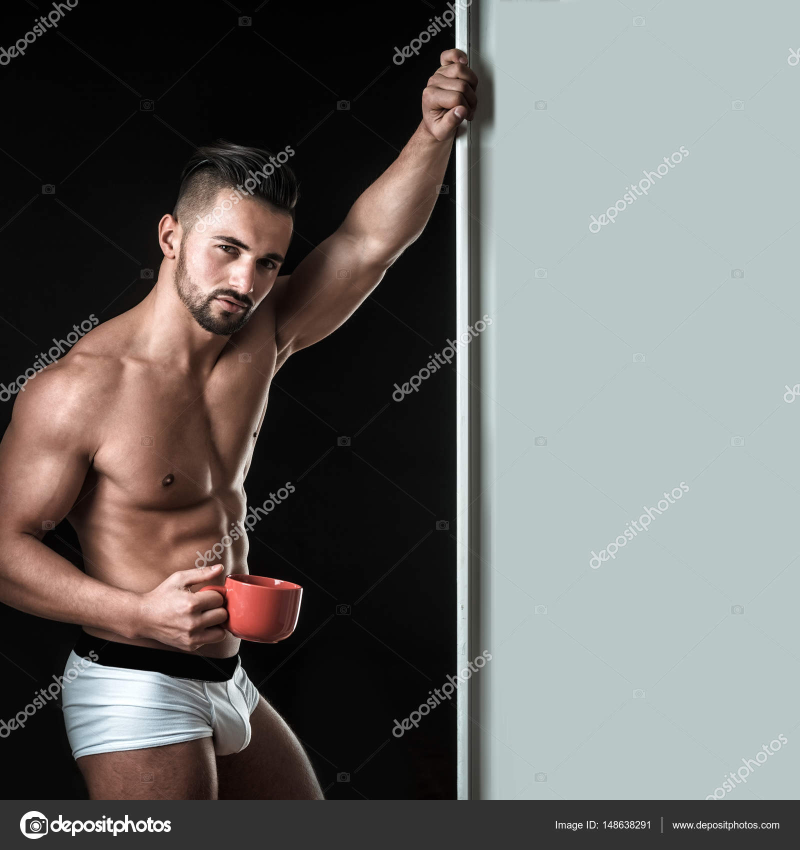 Morning for lonely man. Sexy guy from seductive look. Morning coffee ...