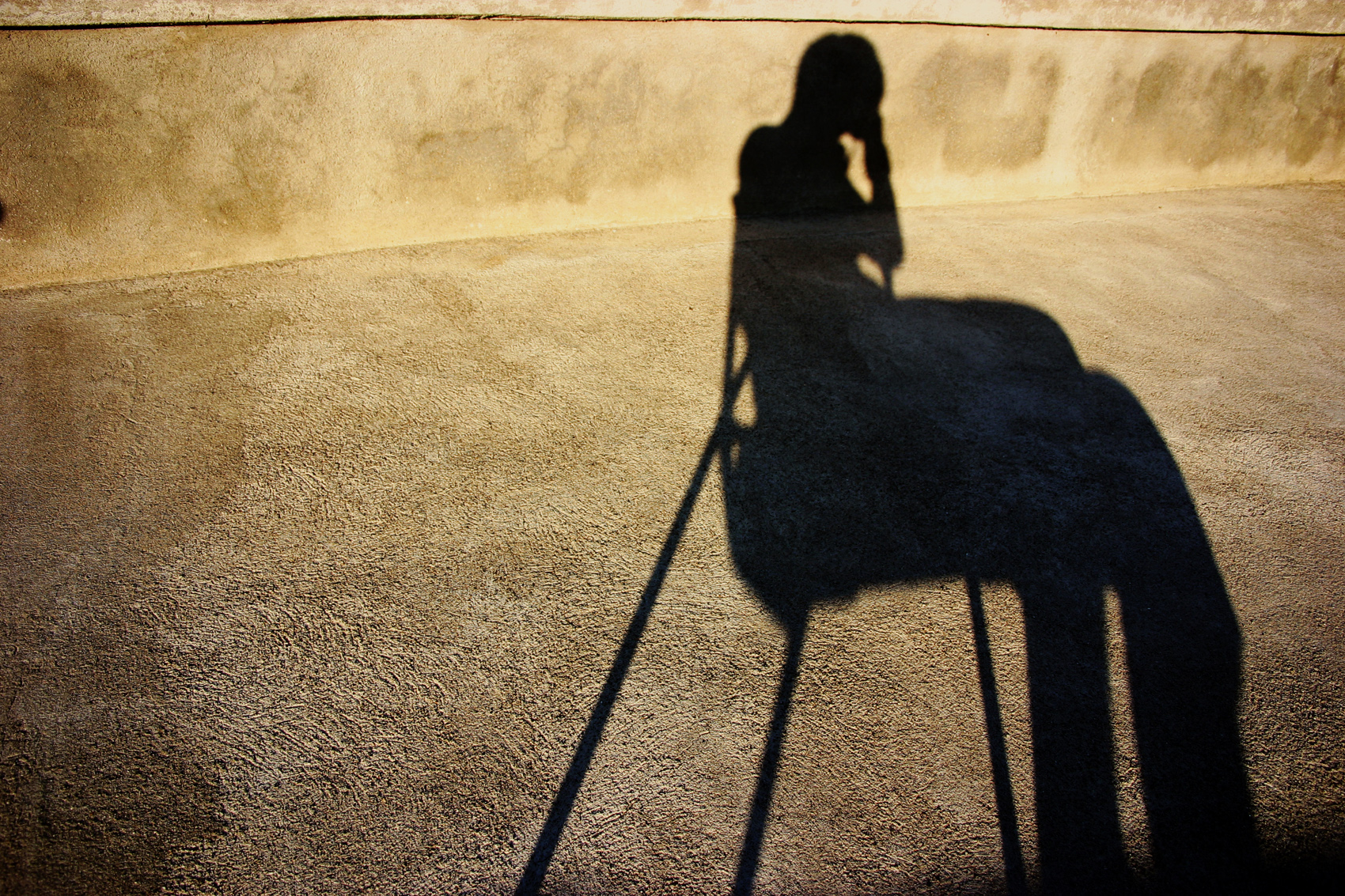 Shadow of a sitting person photo