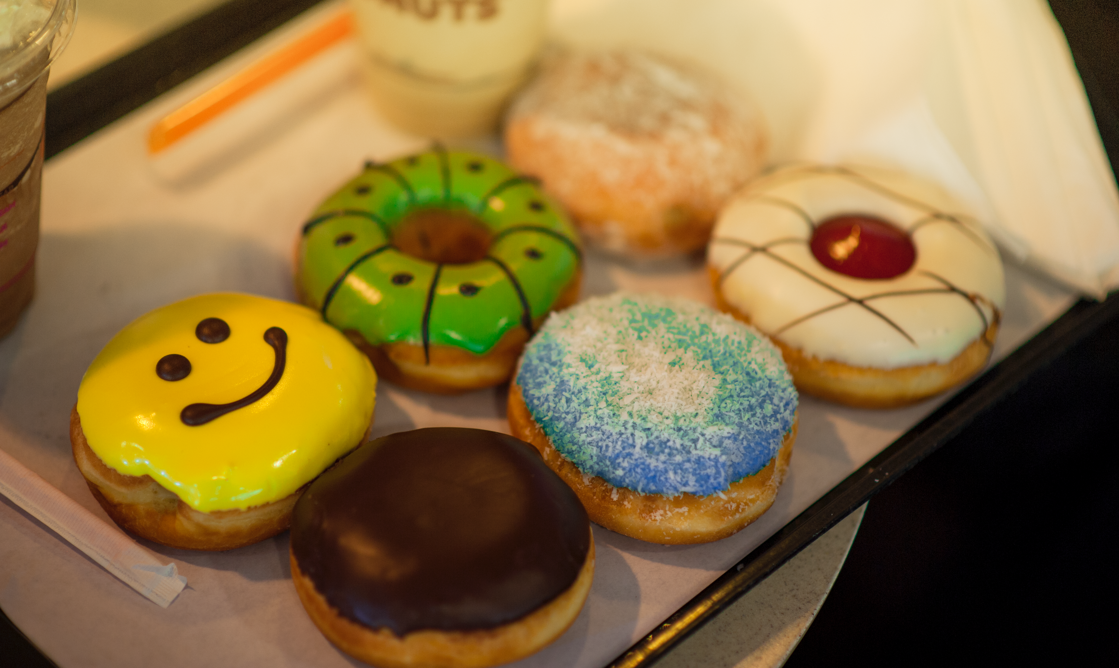 Shallow focus photography of assorted flavored donuts