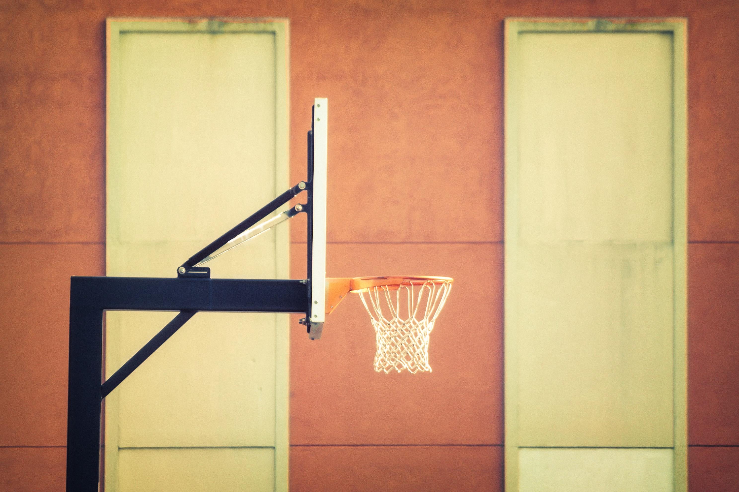 Shallow focus photography of black metal outdoor basketball hoop