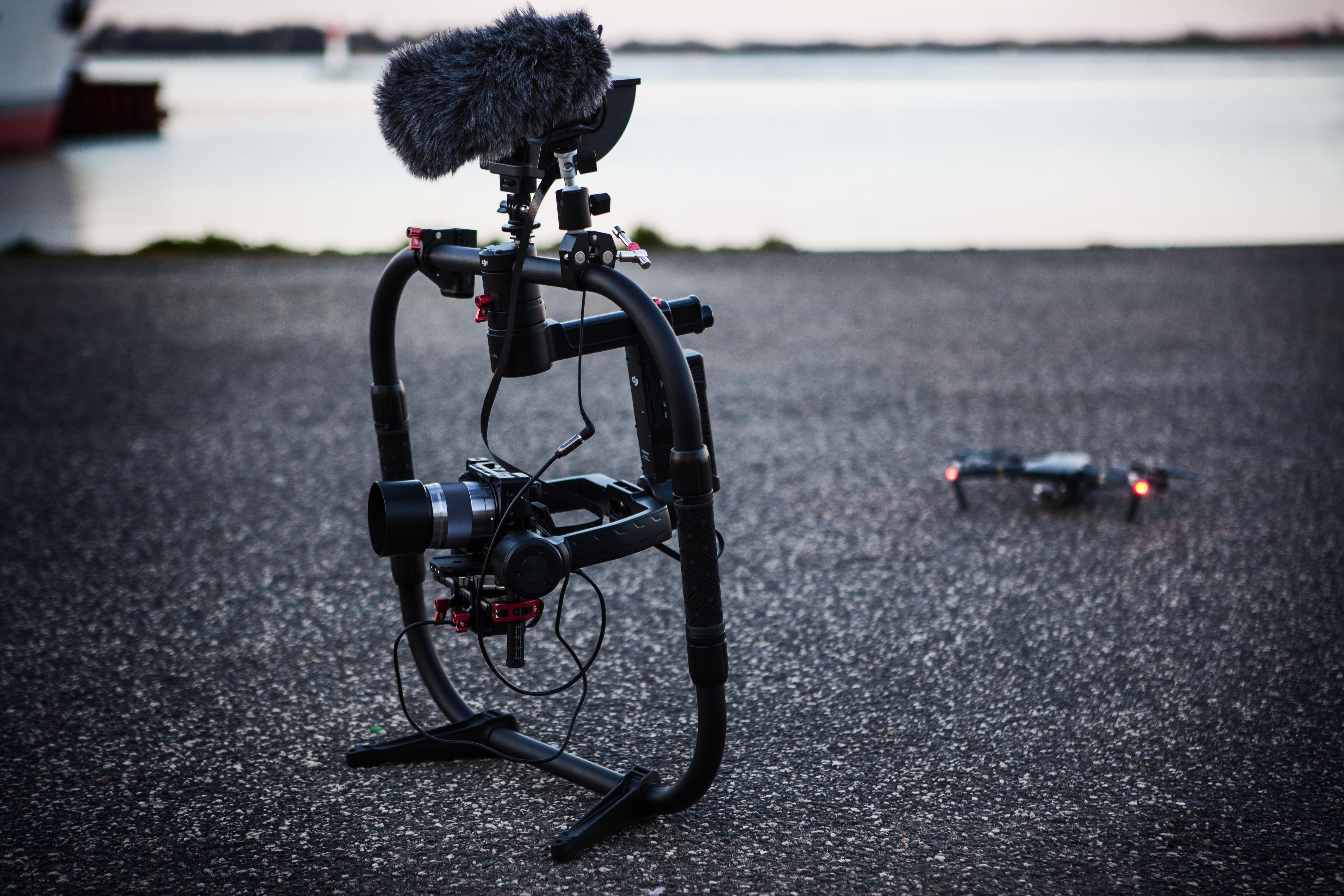 Shallow Focus Photography of Black Quadcopter Near Body of Water, Action, Pavement, Video, Vehicle, HQ Photo