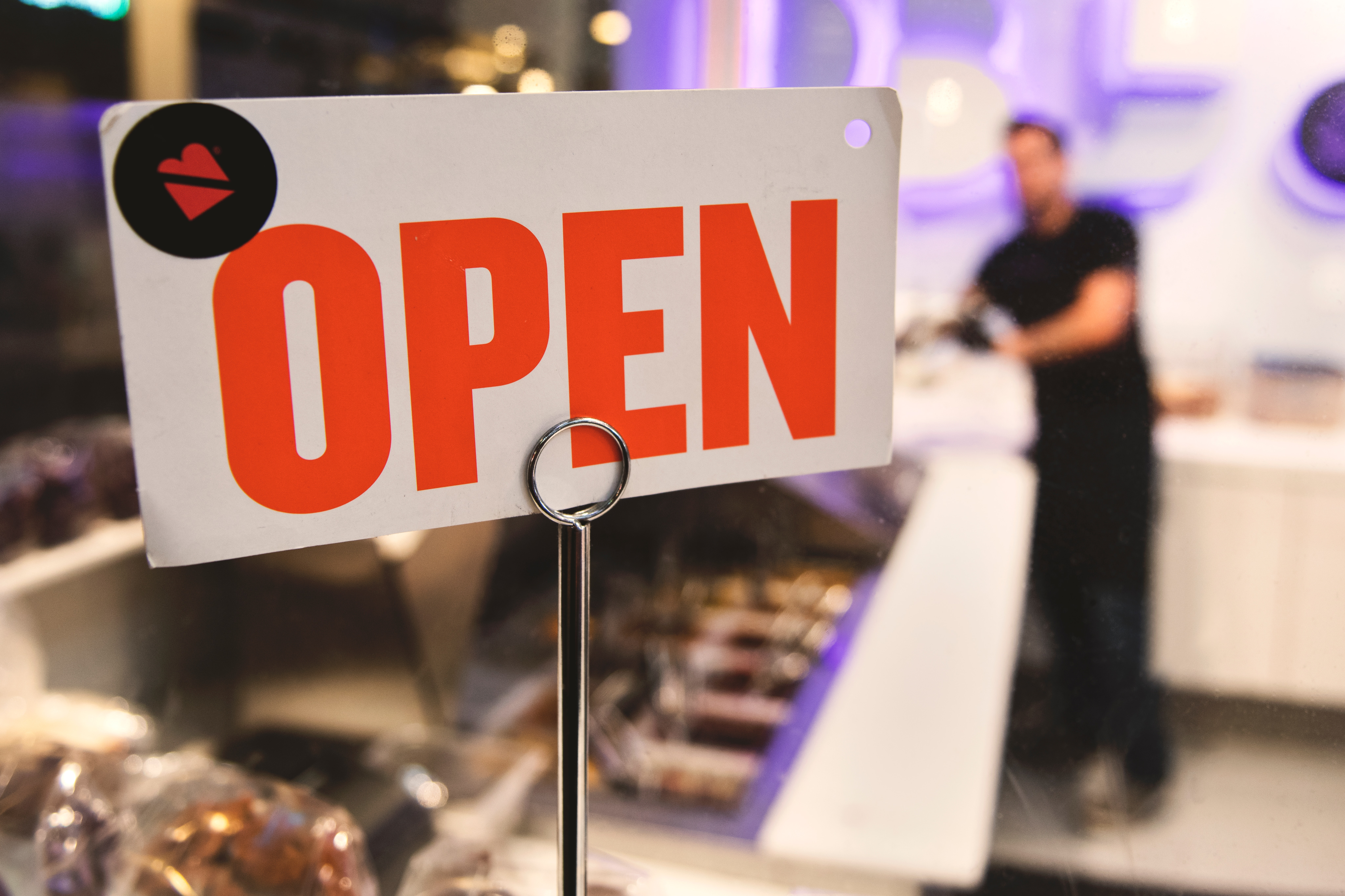 Shallow Focus Photography of Red and White Open Signage Near Man Wearing Black Shirt, Shopping, Shop, Service, Sign, HQ Photo