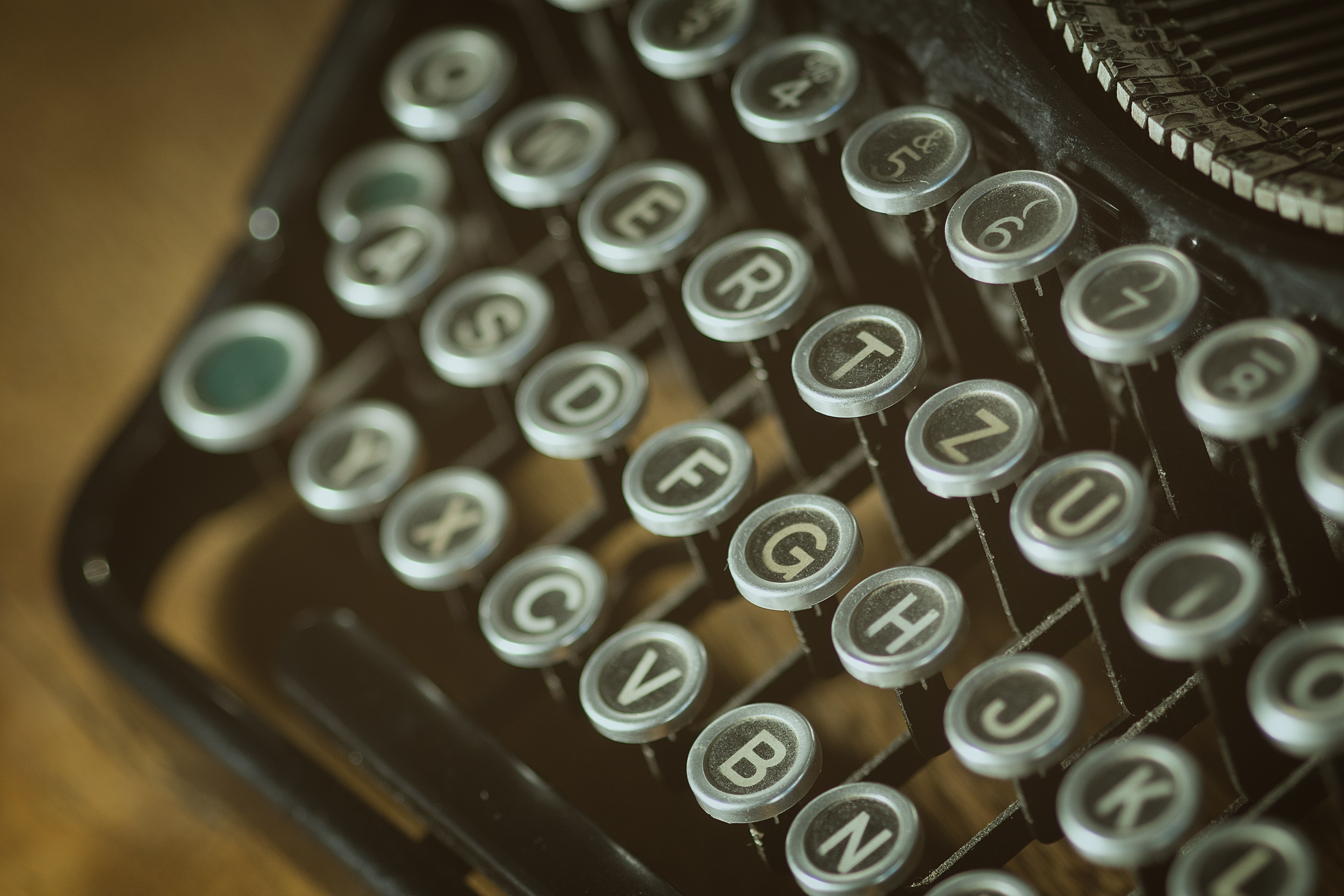 Shallow photoghrapy of black and gray type writer keys
