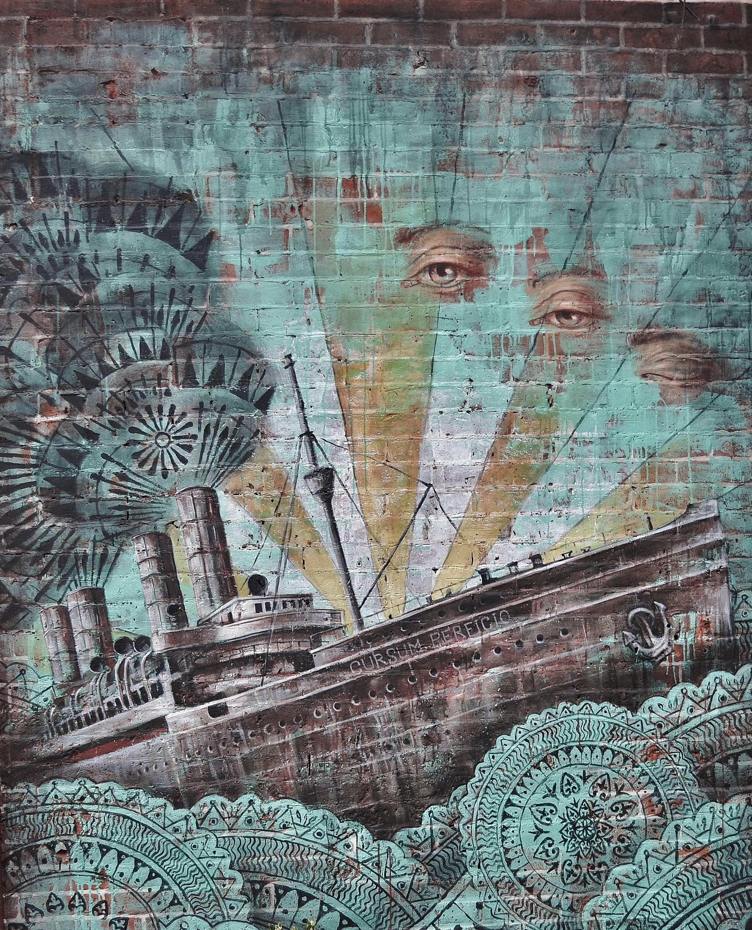 Ship and human eye painted on wall photo