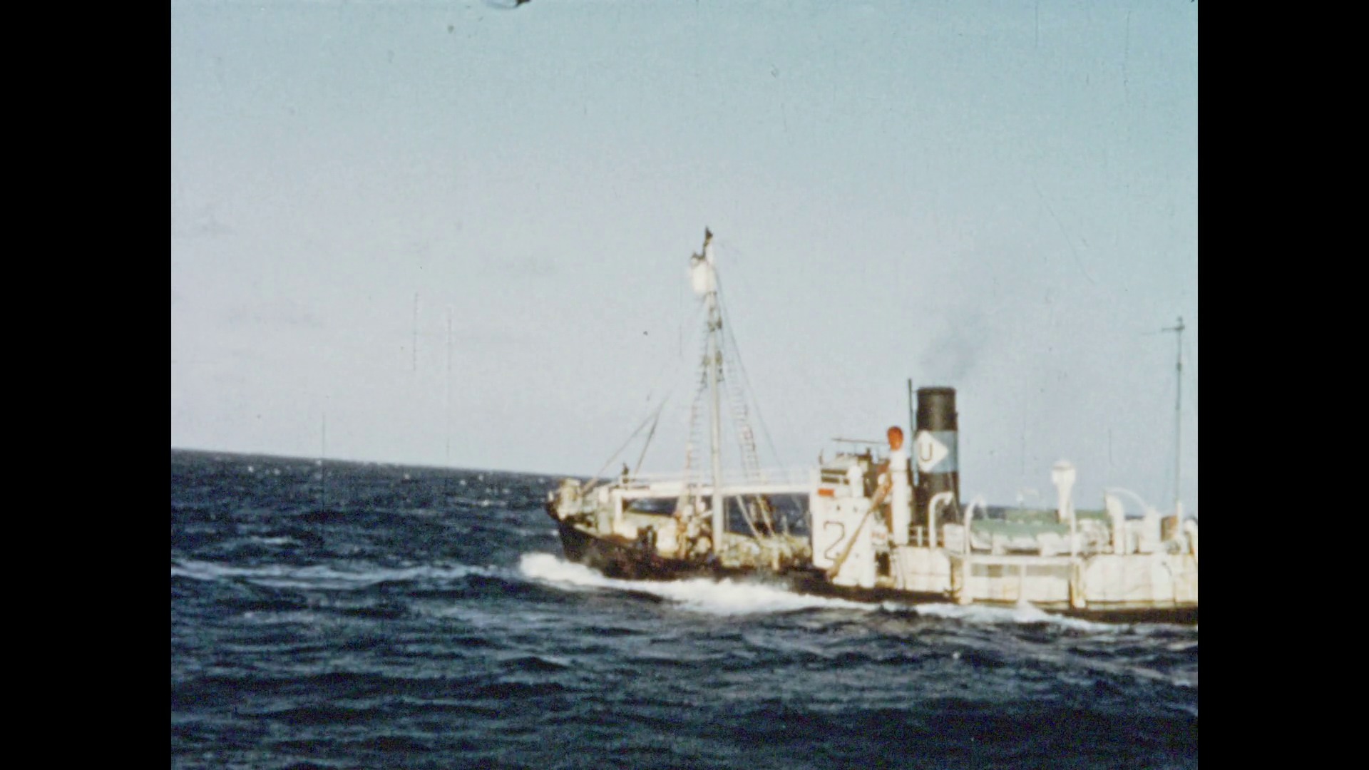 1950s: DURBAN, SOUTH AFRICA: whaling ship at sea. Whaler men prepare ...