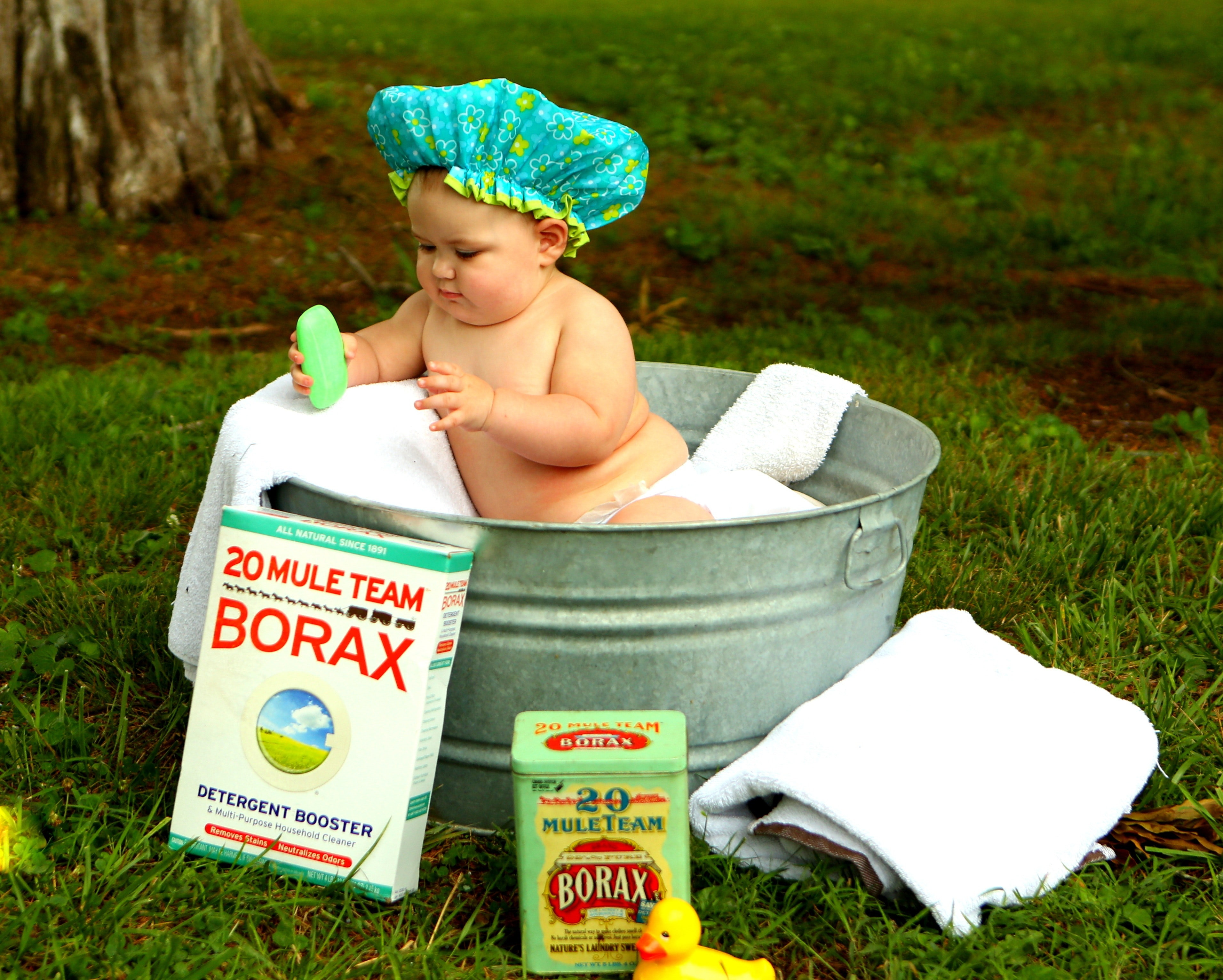 Shirtless baby boy in galvanized tub photo