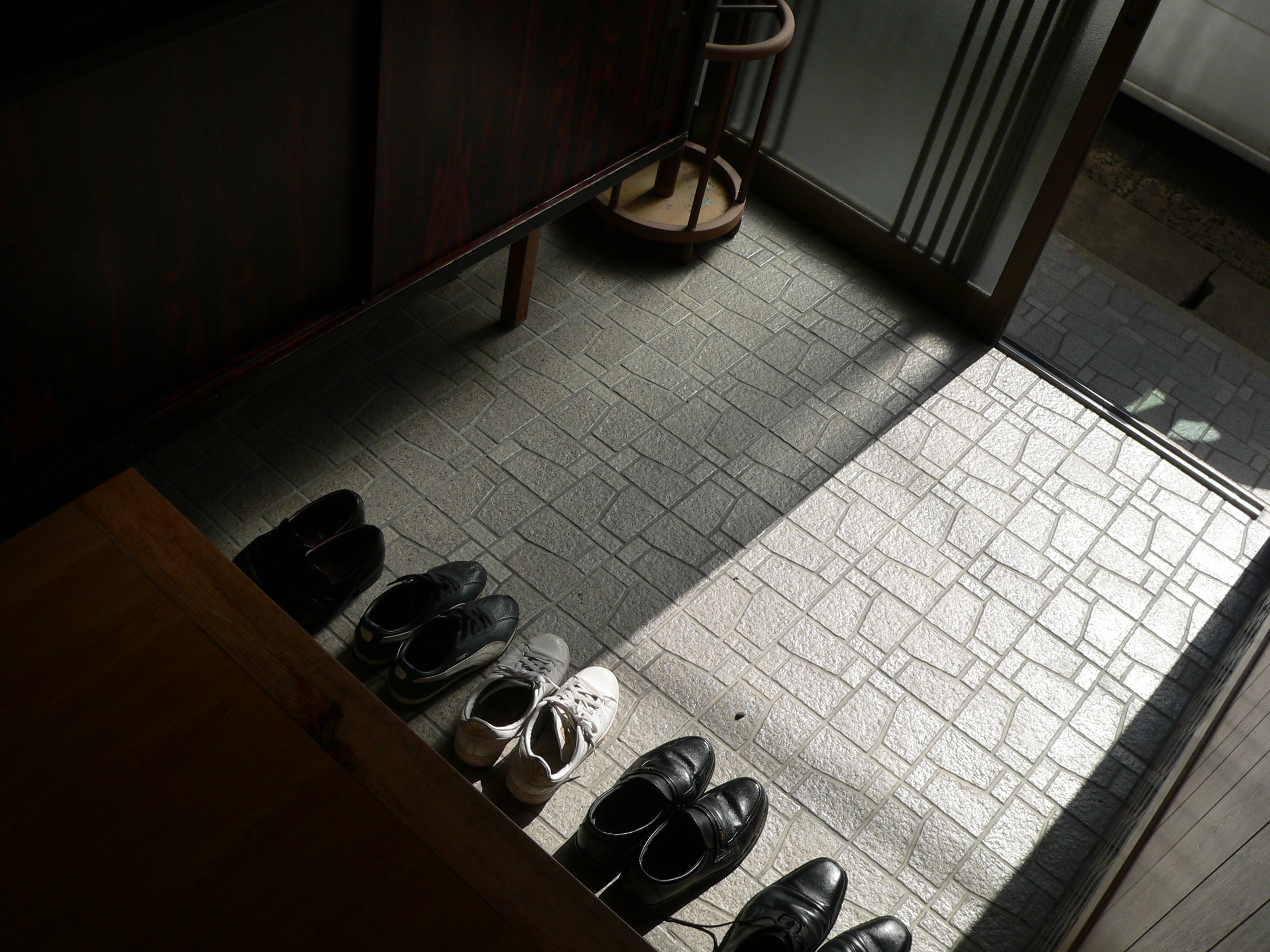 Shoes in the hallway of a japanese house photo