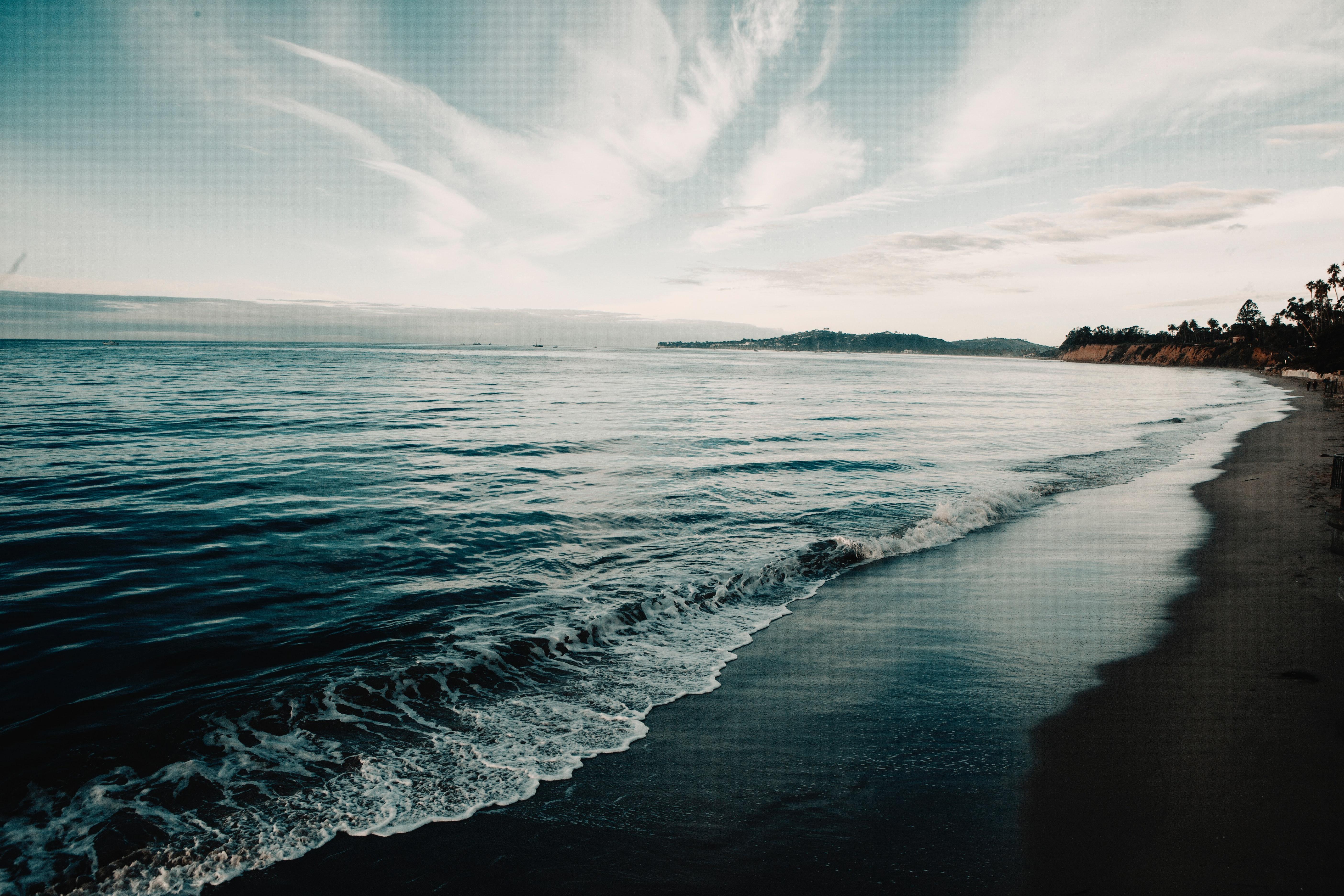 Shoreline under blue sky photo