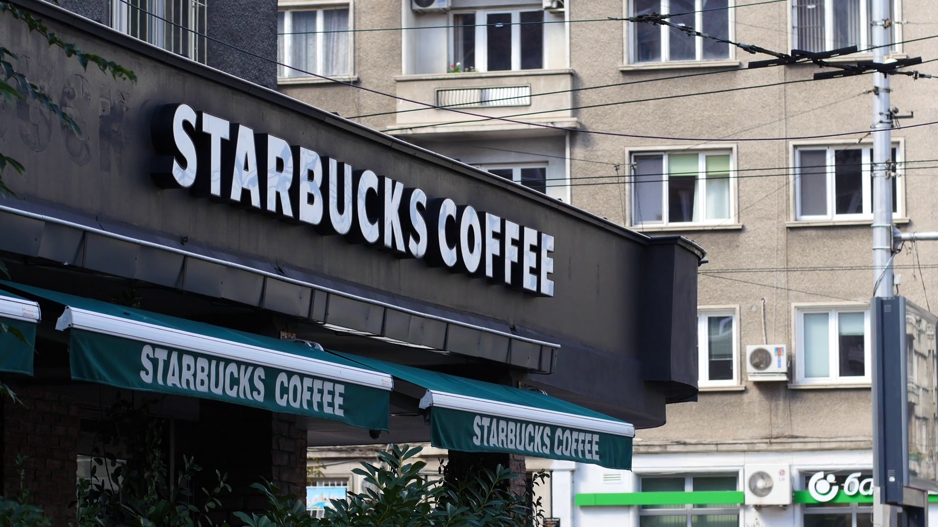 Sofia, Bulgaria - Starbucks coffee signboard above storefront cafe ...