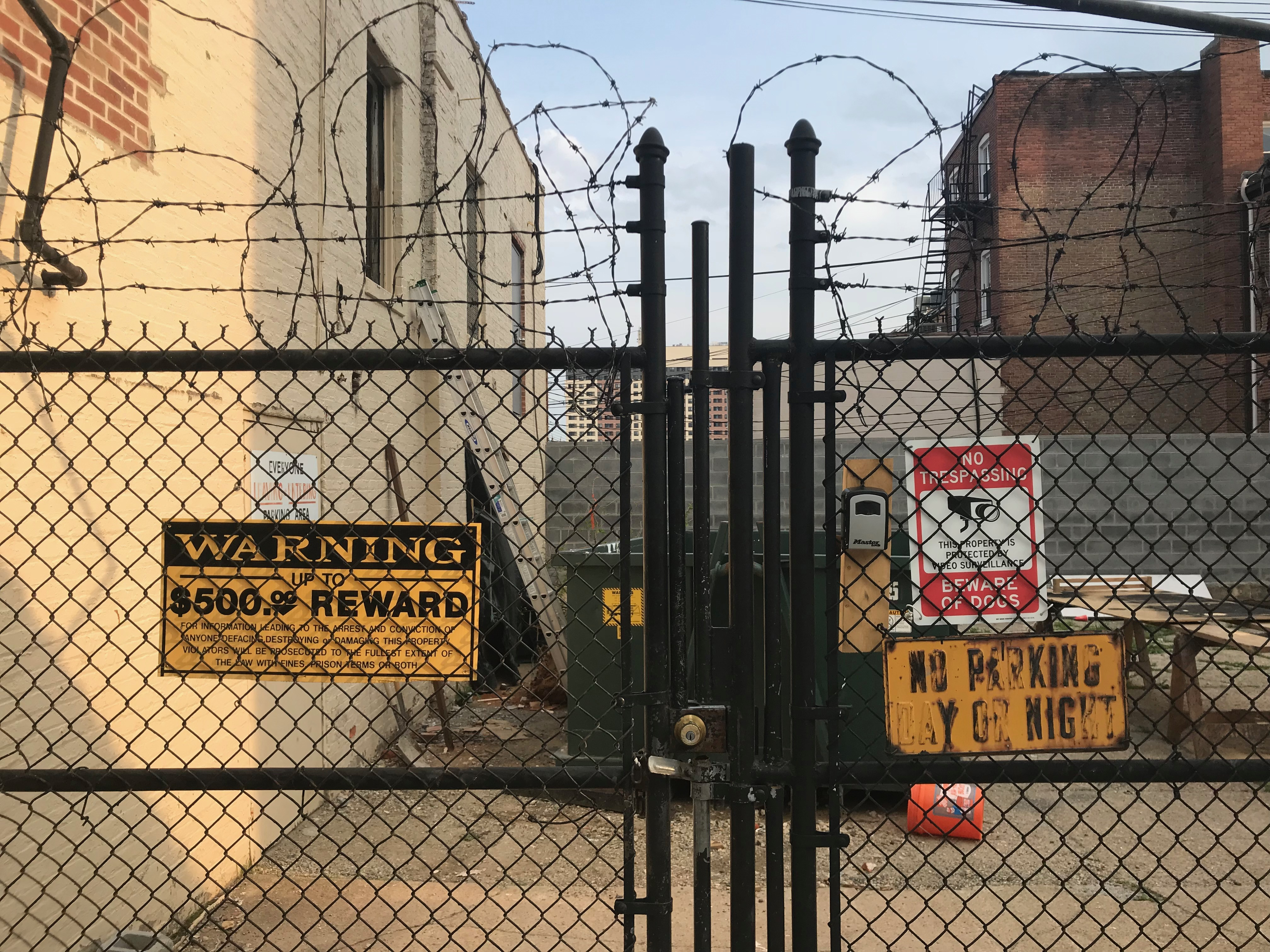 Signs and fence along W. 23rd Street between Maryland Avenue and Morton Street, Baltimore, MD, 23rd Street, Baltimore, Dumpster, Fence, HQ Photo