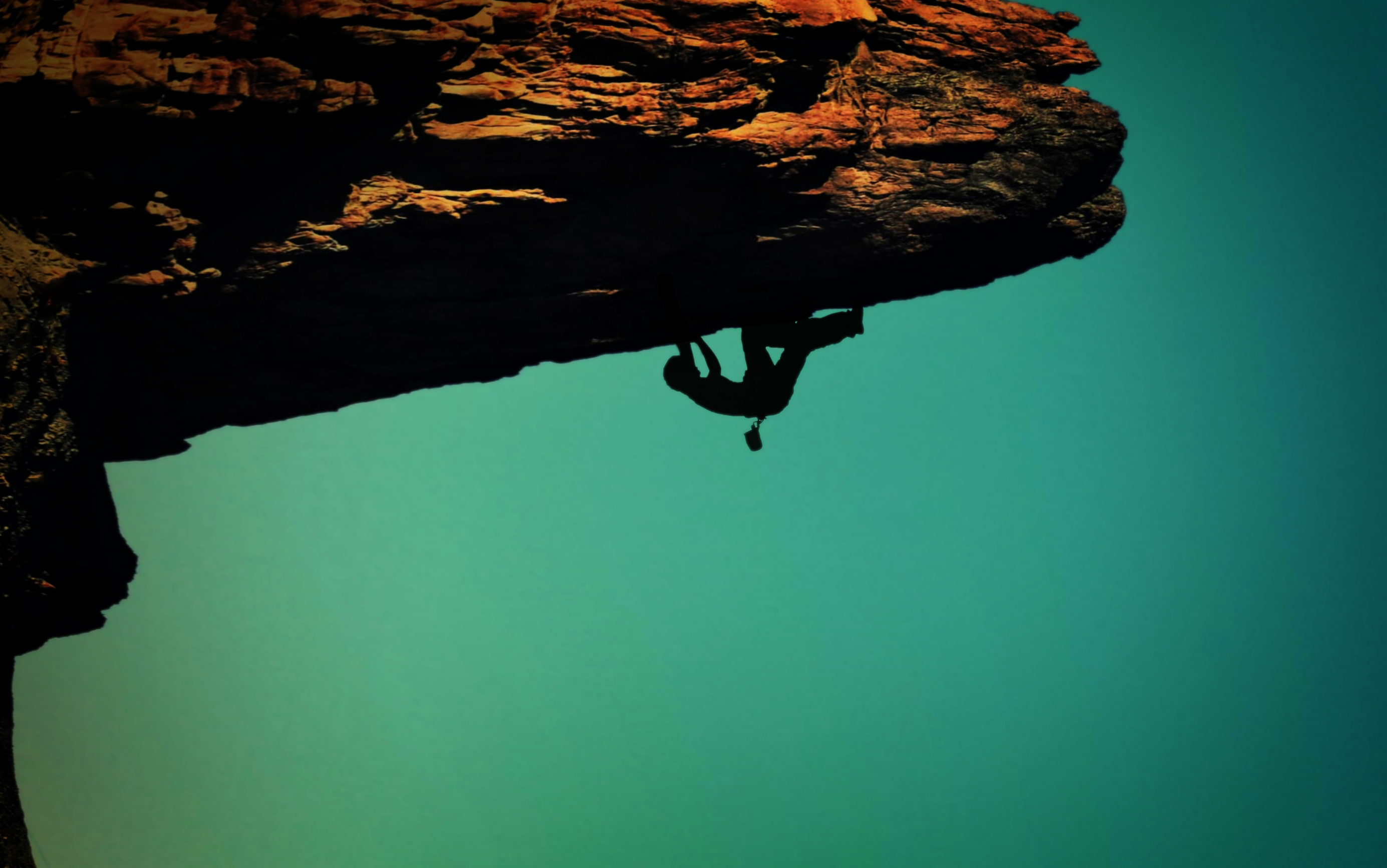 Silhouette of a rock-climber photo