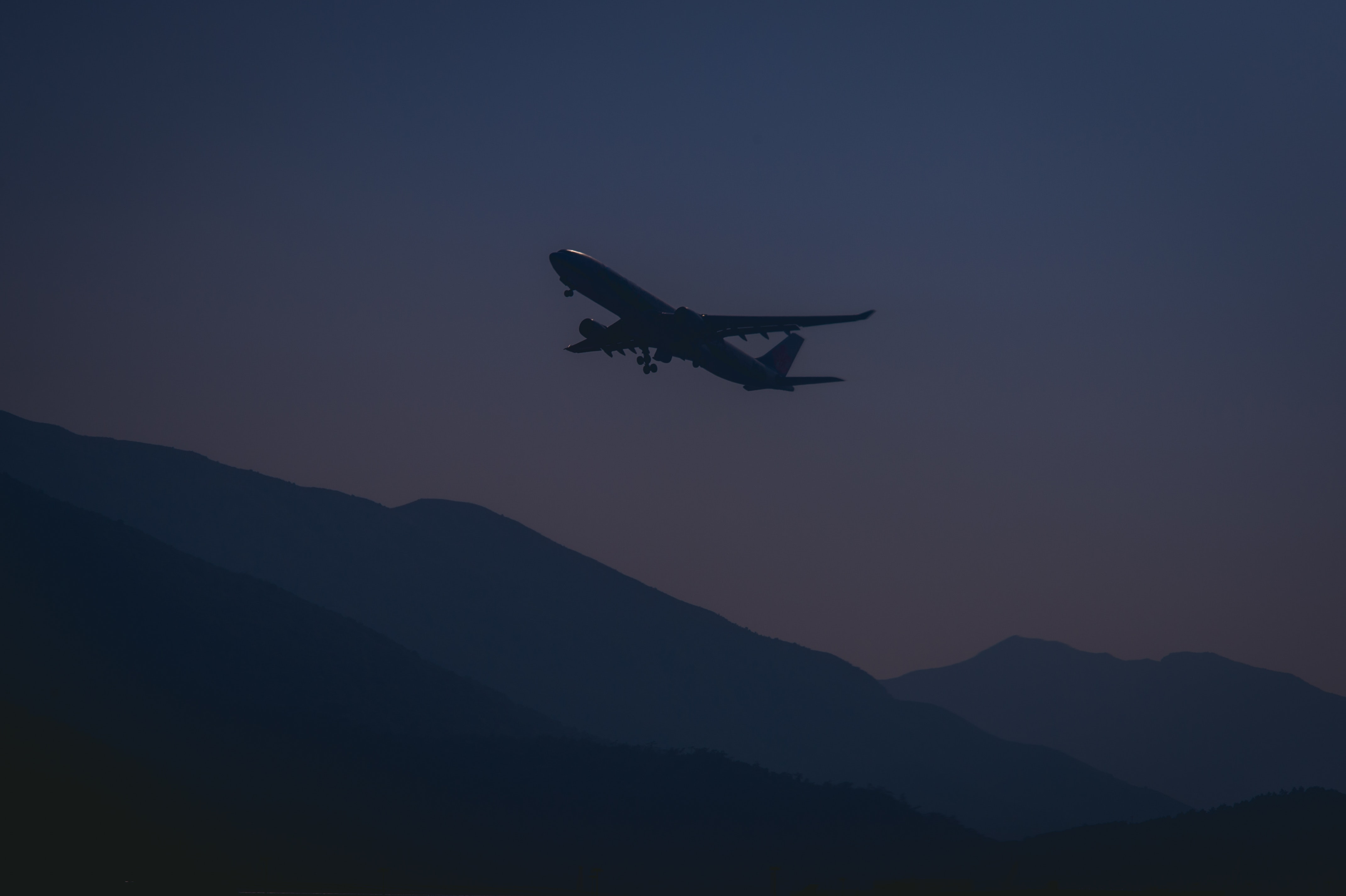 Silhouette of airplane during evening photo