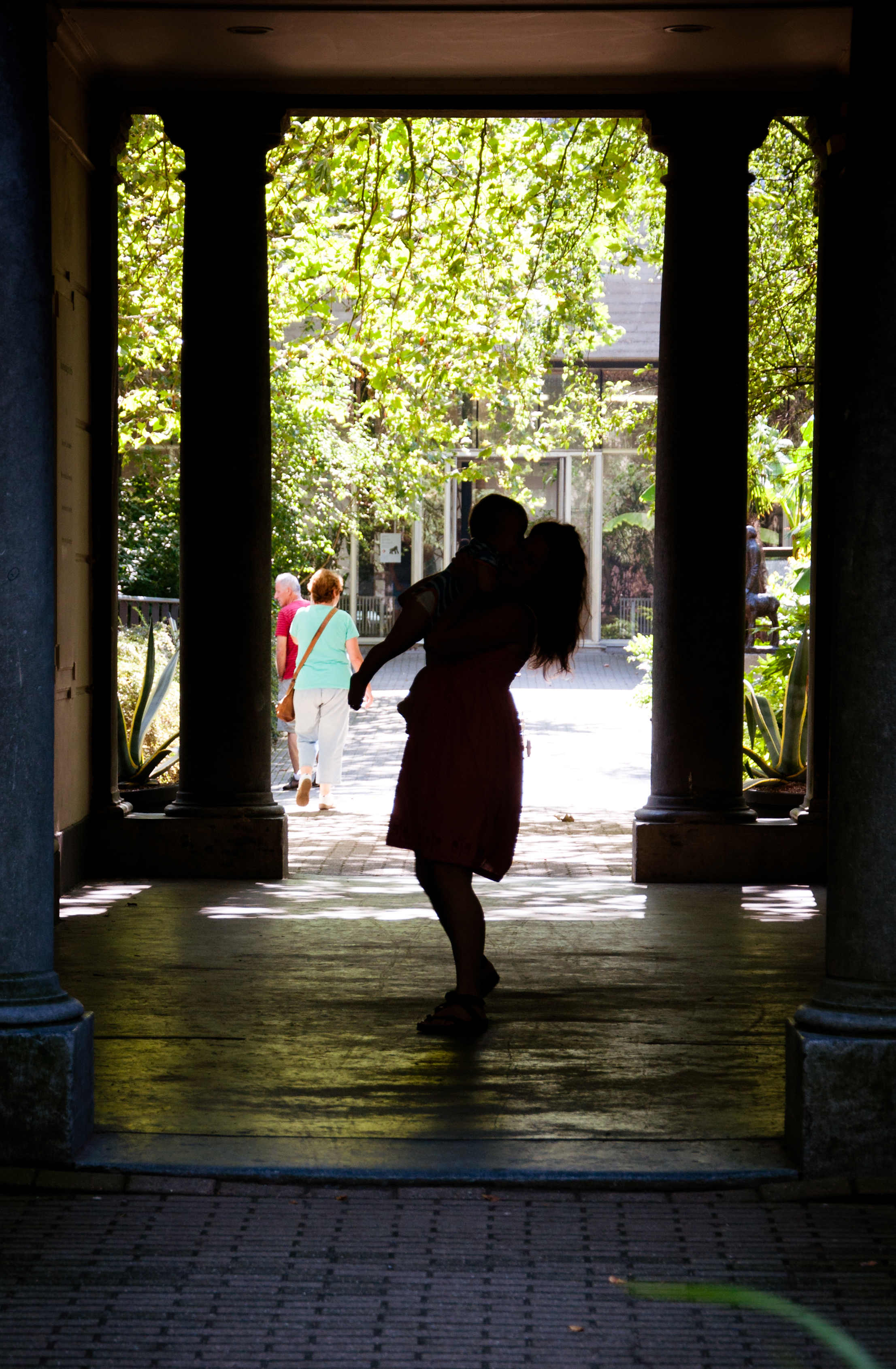 Silhouette of mother dancing with child photo