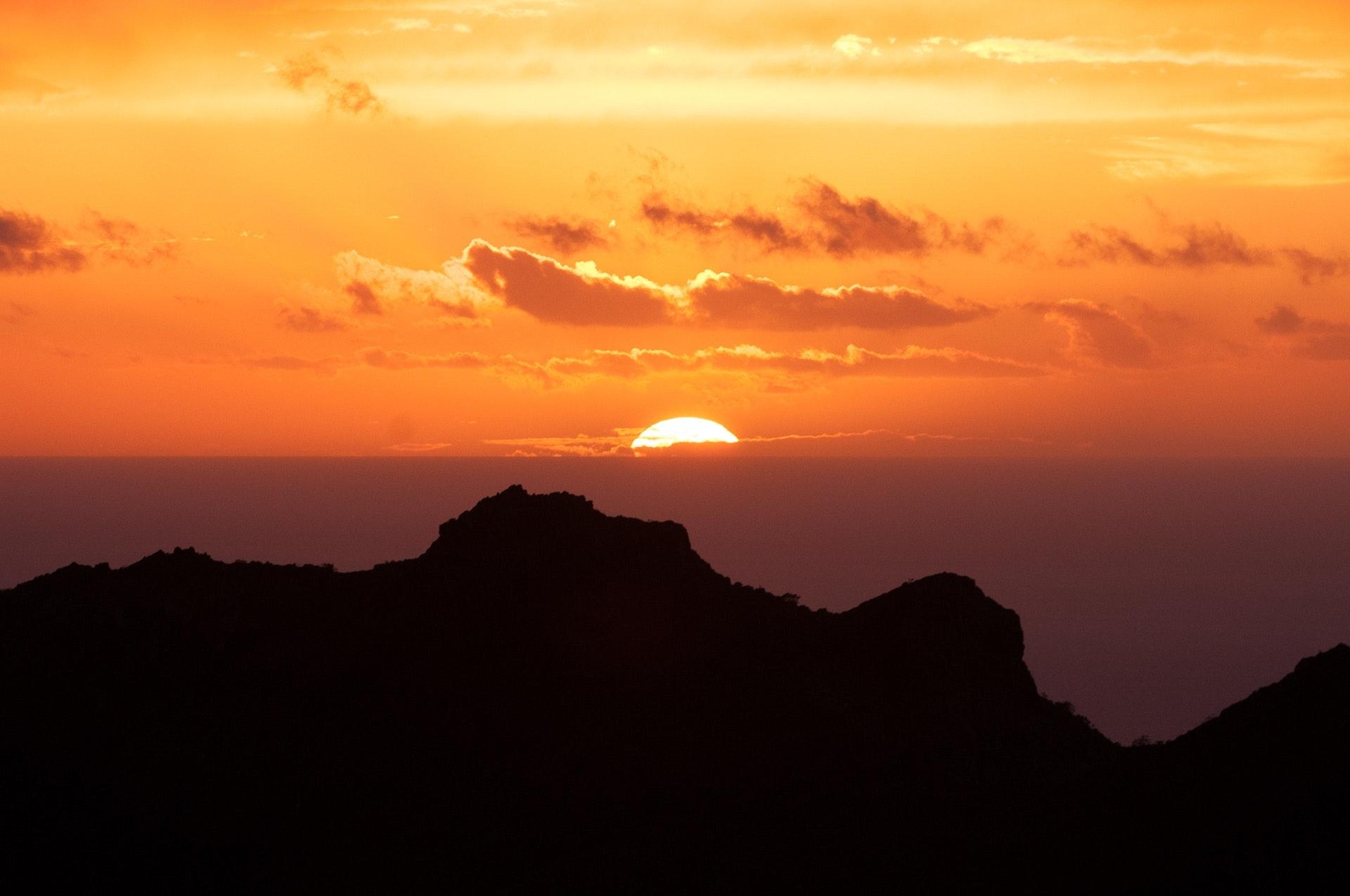 Silhouette of mountain under sunset photo