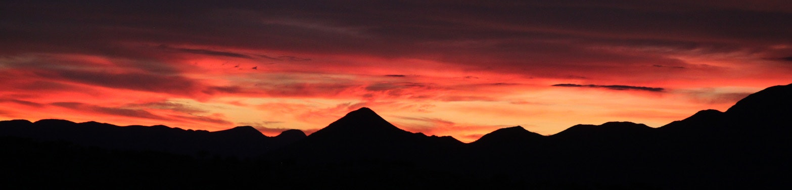 Silhouette of mountains during dawn photo