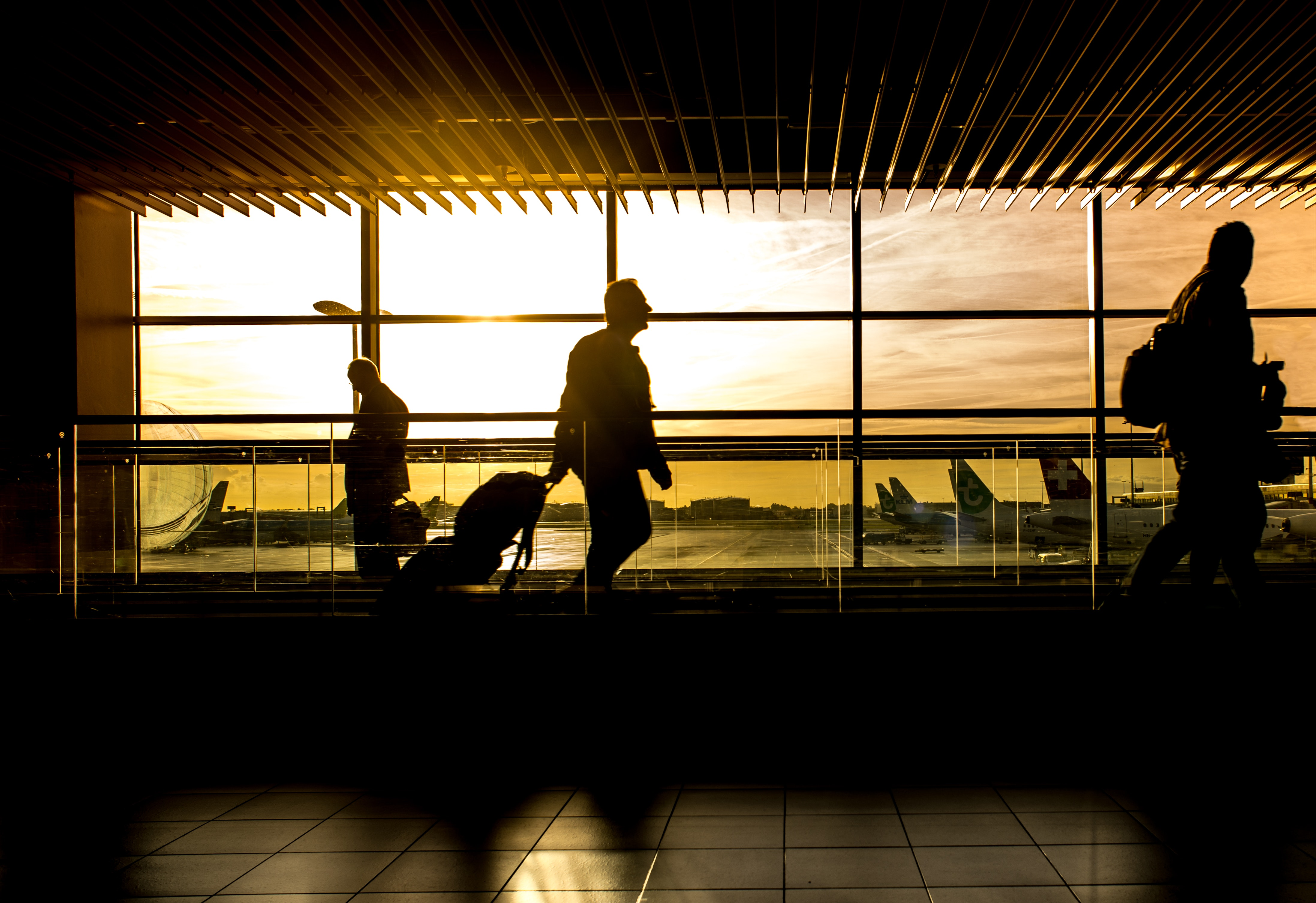 Silhouette of person in airport photo