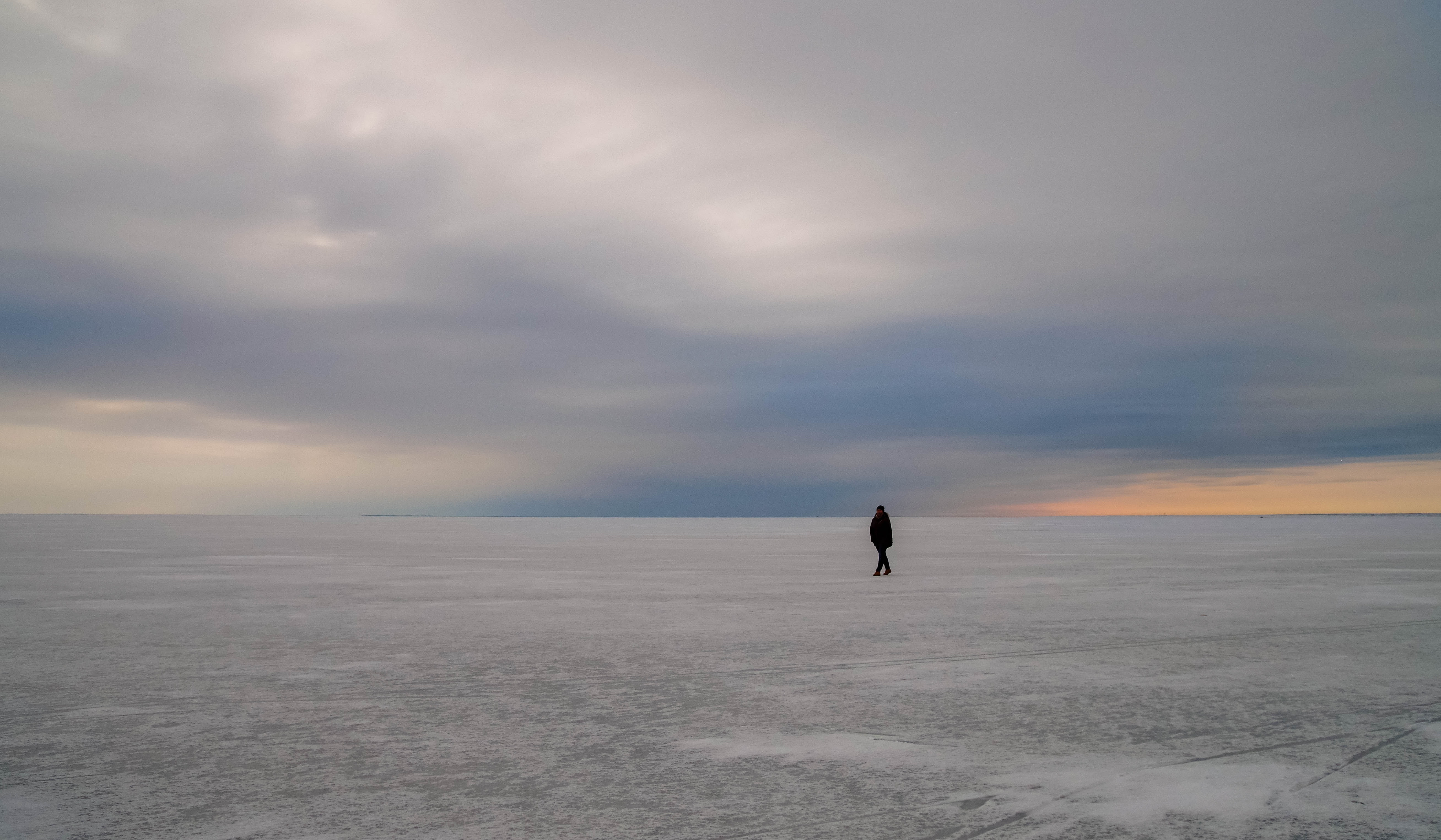 Silhouette of person walking on vast land photo