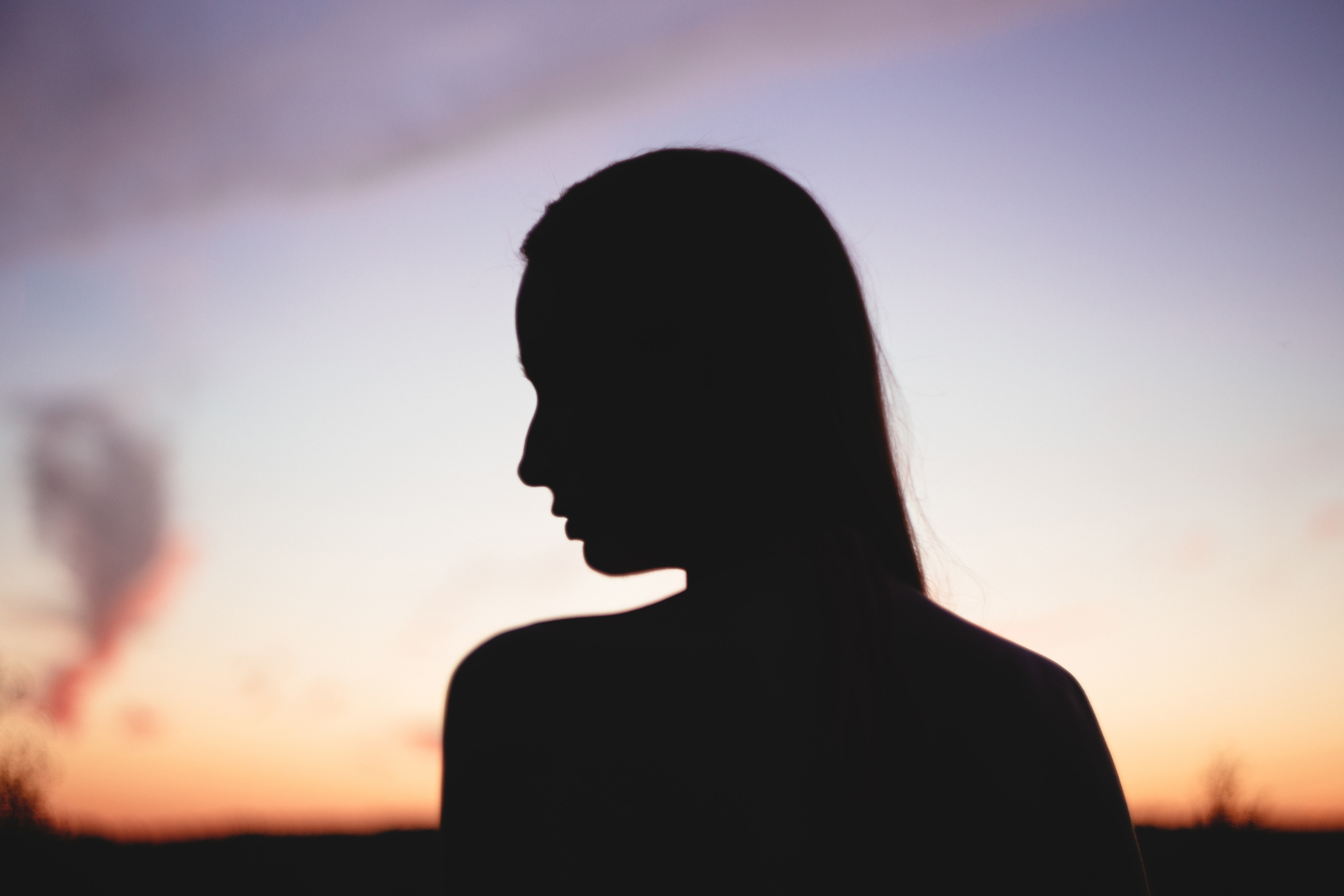 Silhouette of woman during sunset photo