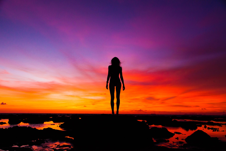 Photographer silhouette woman