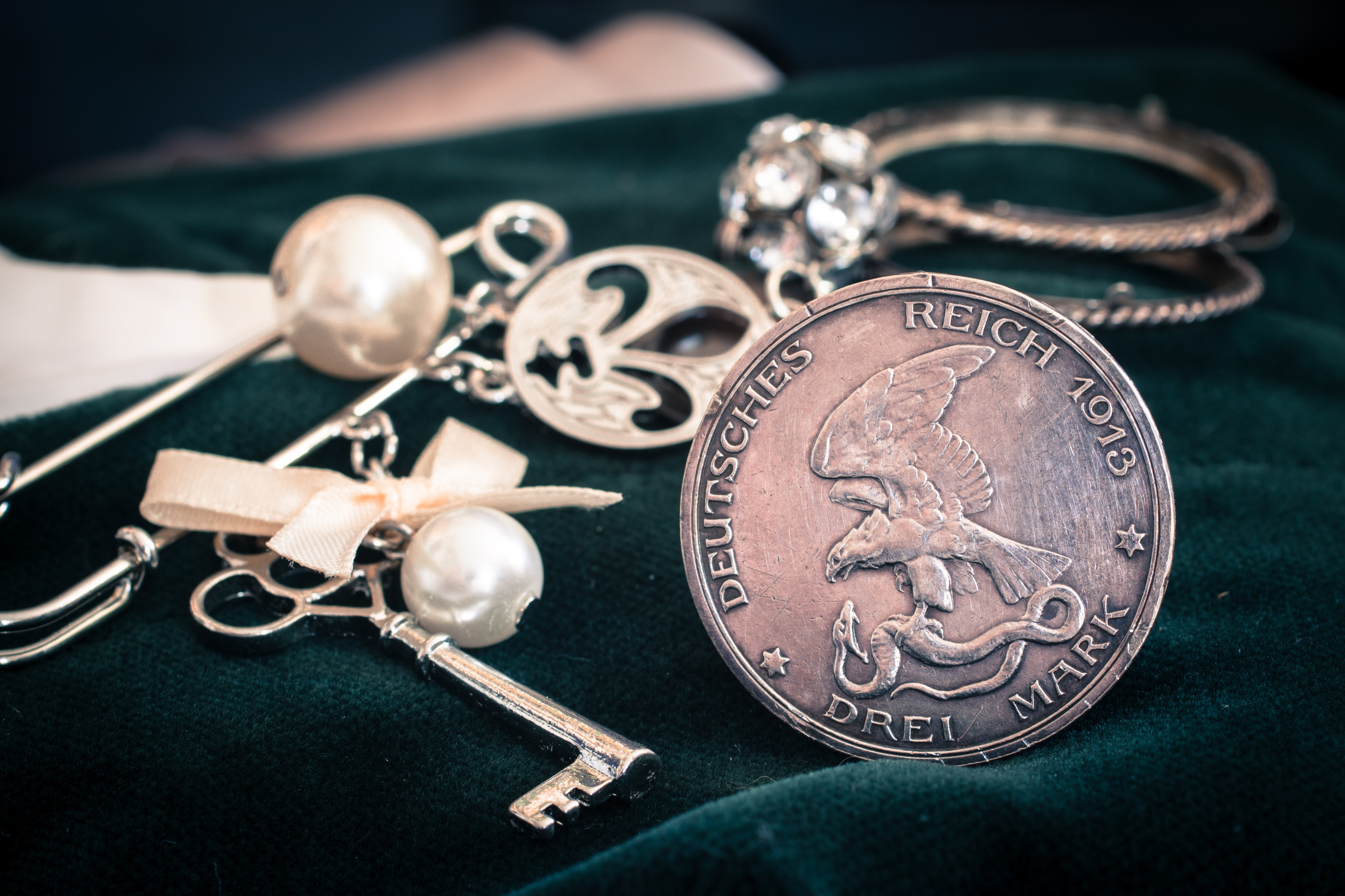Silver coin and jewelry photo