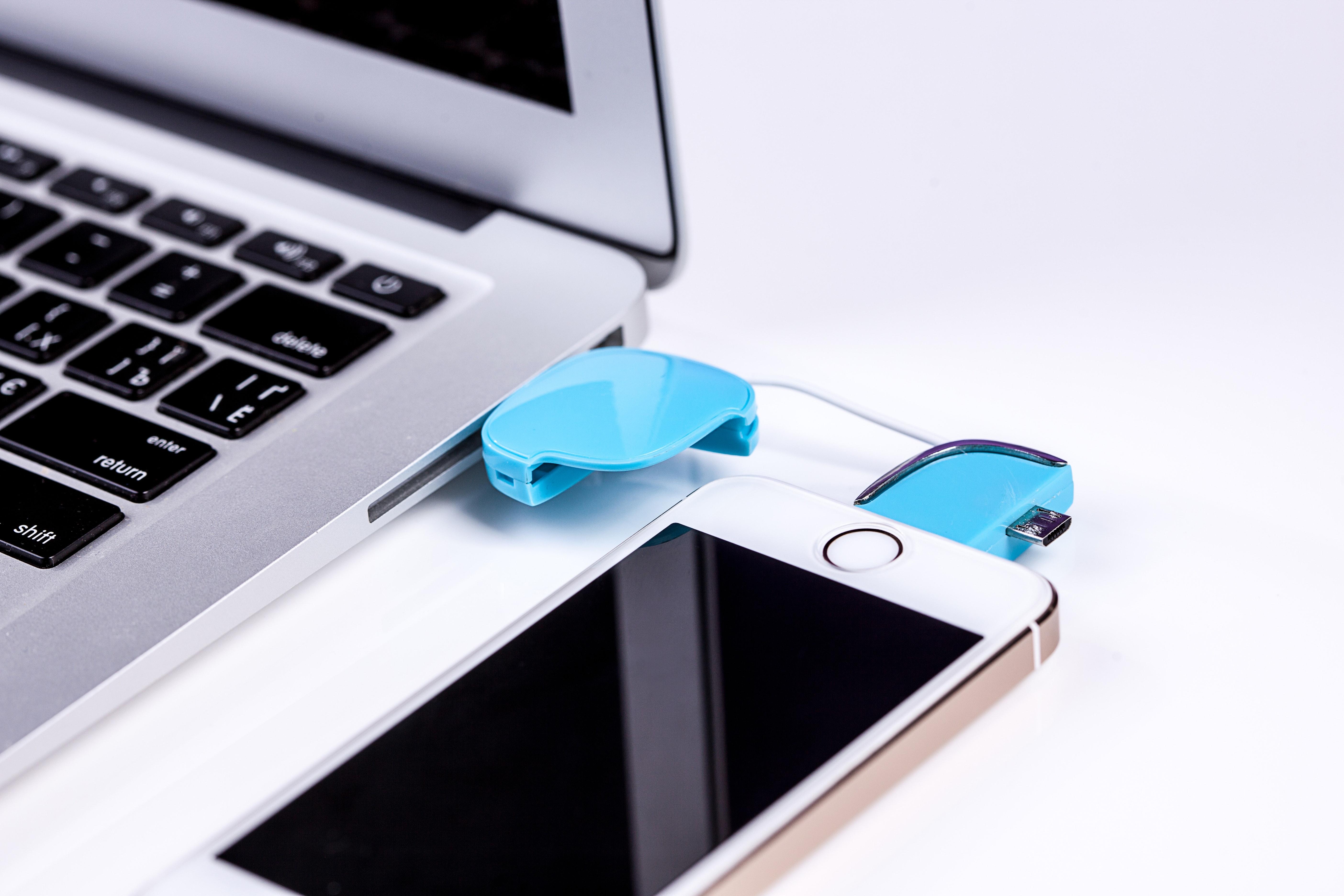 Silver iphone 5s near macbook photo