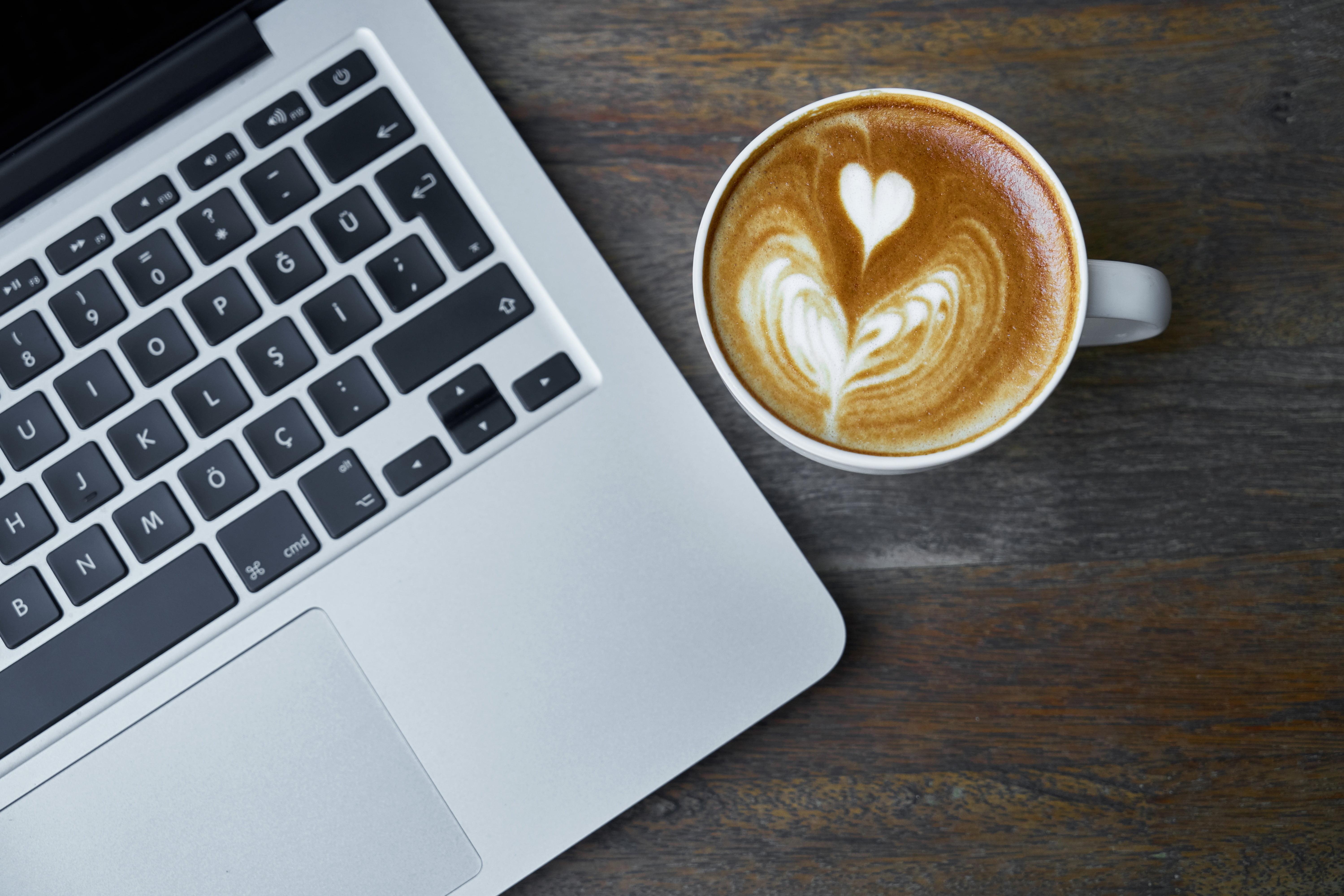 MacBook Pro beside white ceramic mug with espresso HD wallpaper ...