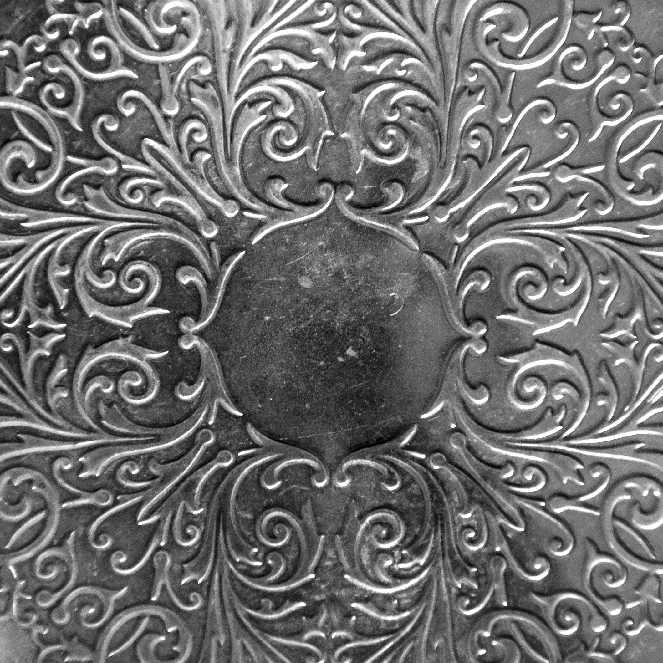 Silver metal plate with classic ornament photo