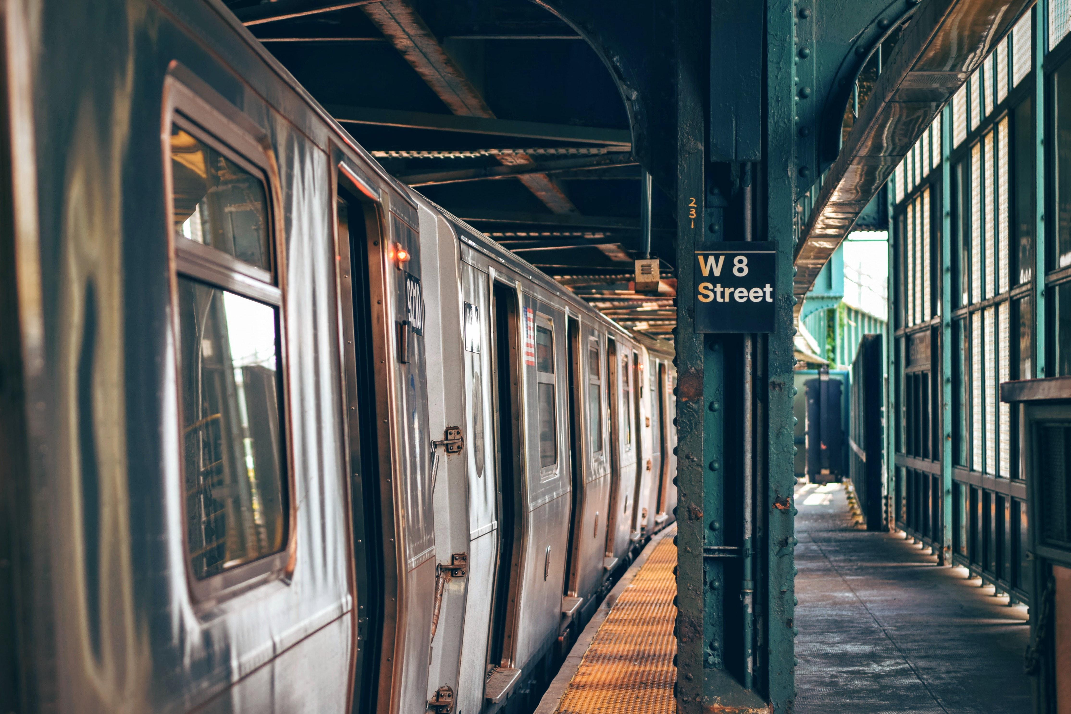 Silver train on w8 street platform photo