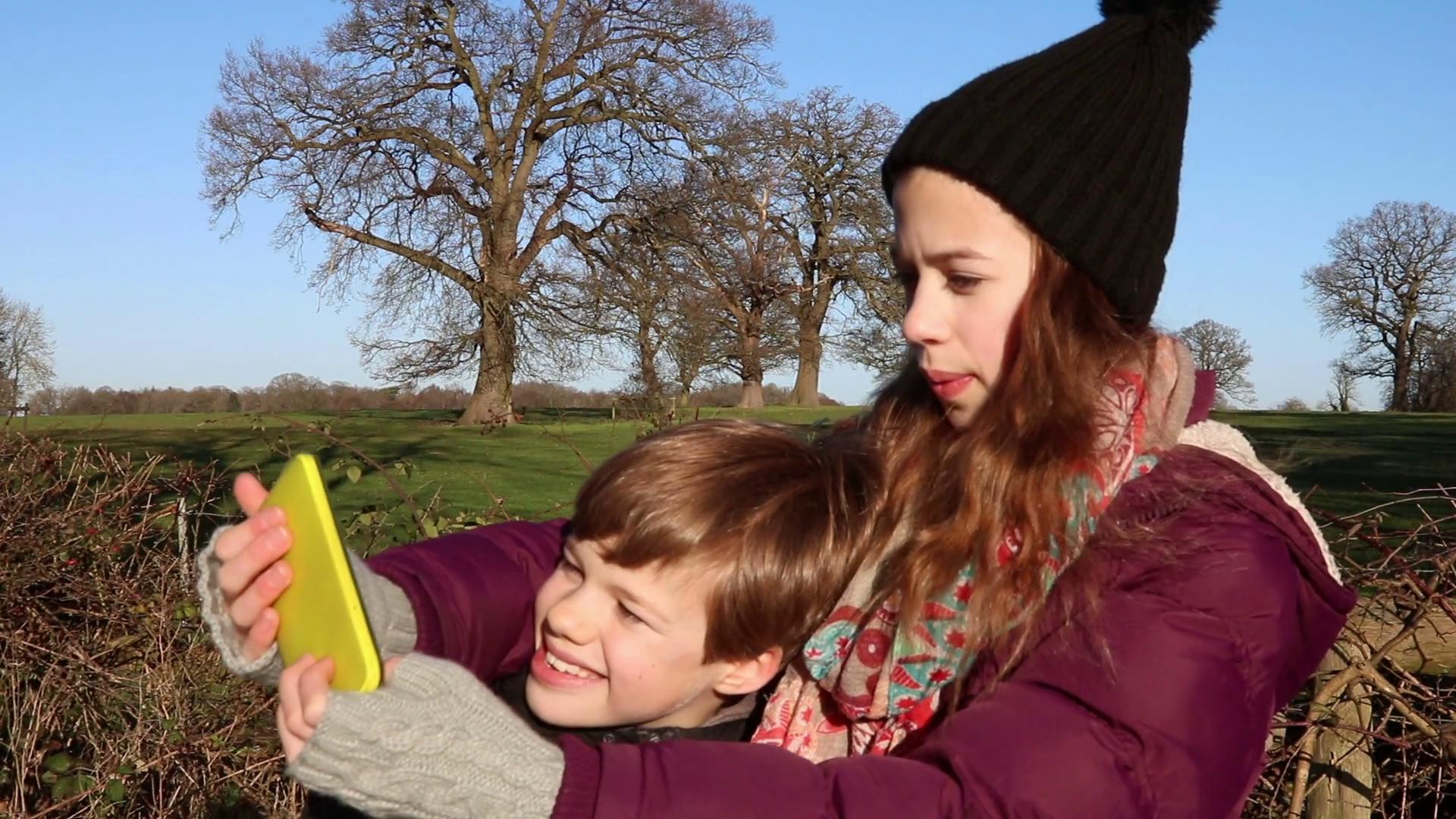 Brother Sister Taking Selfie Stock Video Footage - Videoblocks