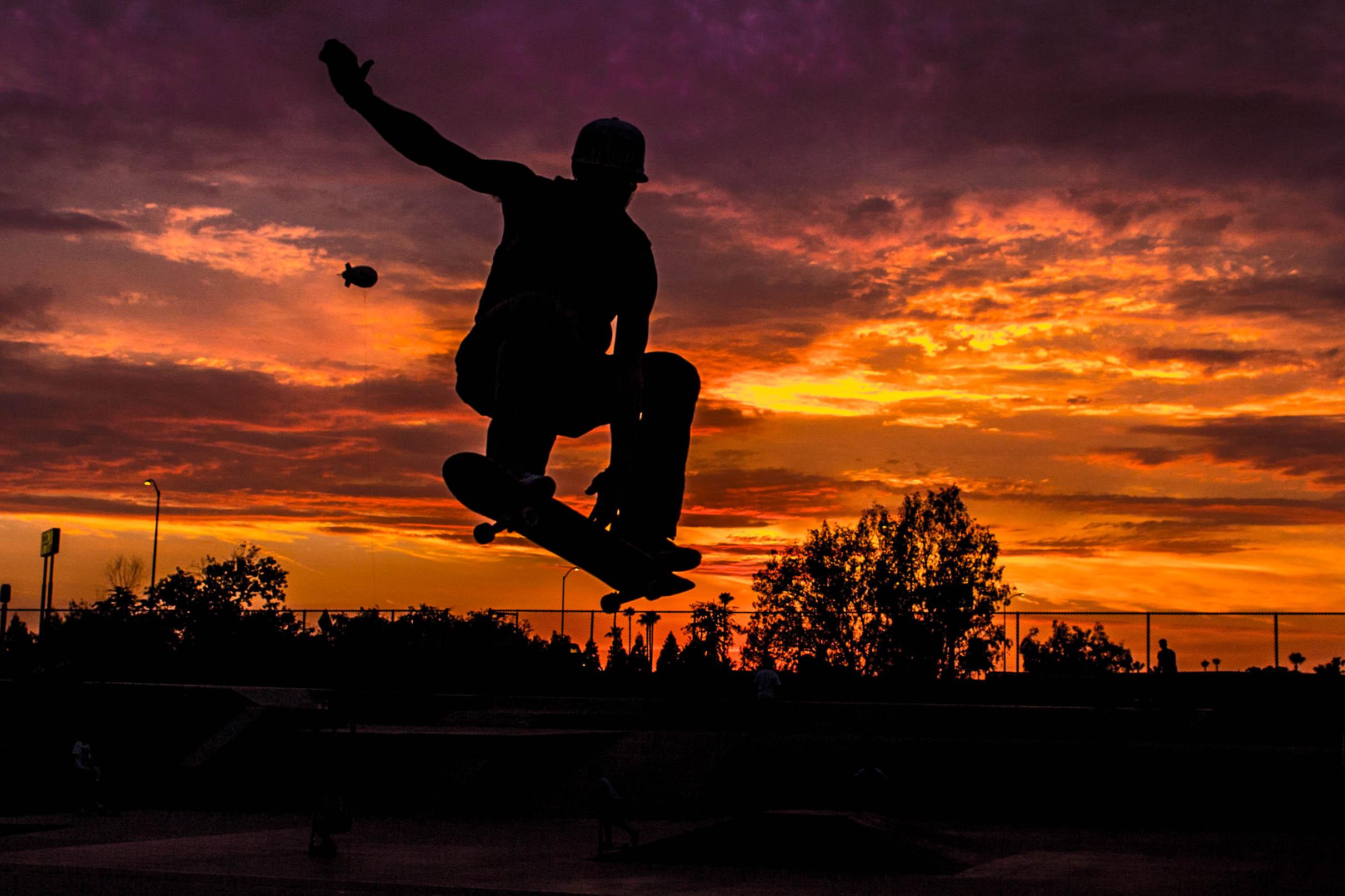 Skateboarding silhouette sunset