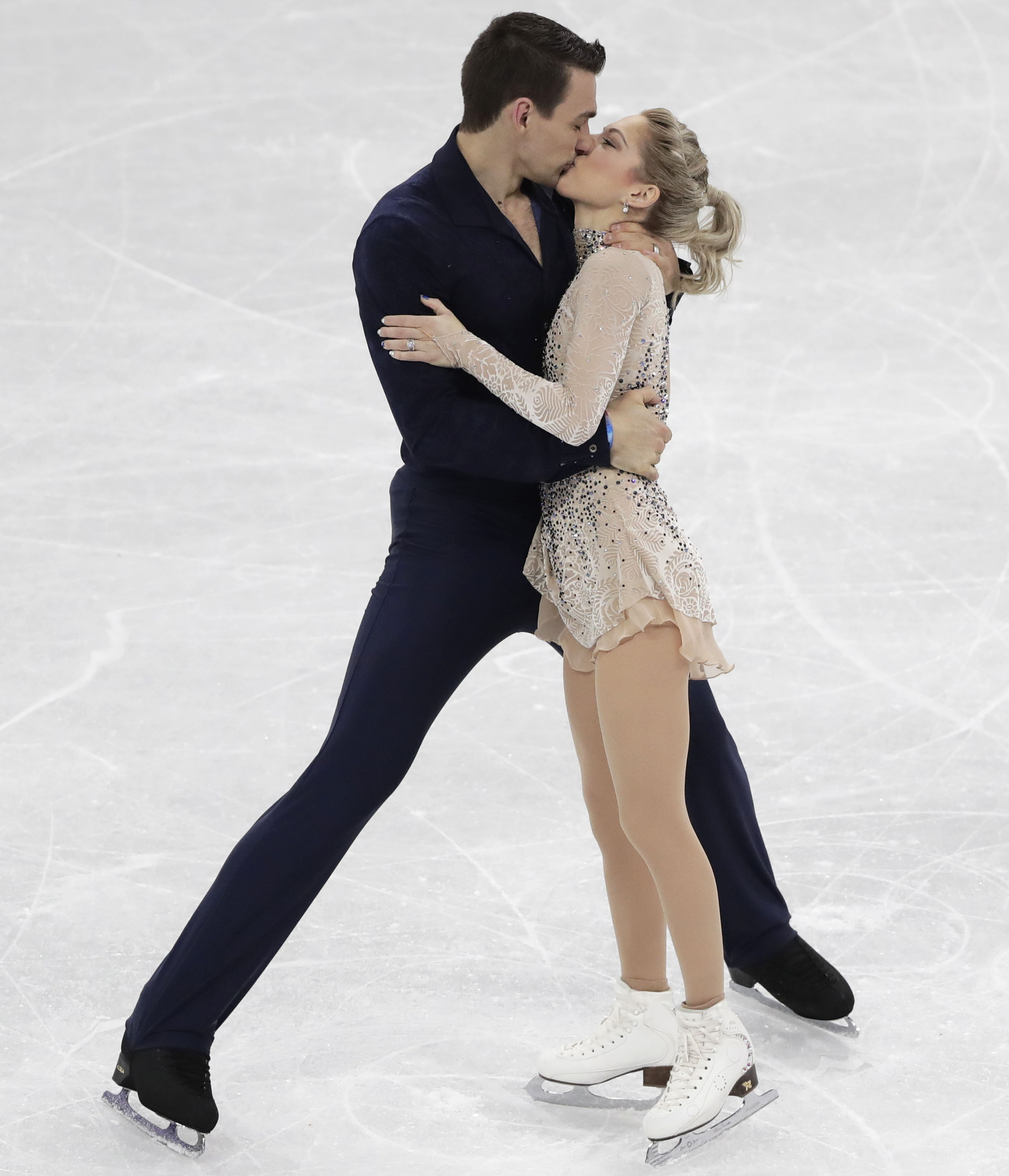 American skaters share kiss on Olympic ice