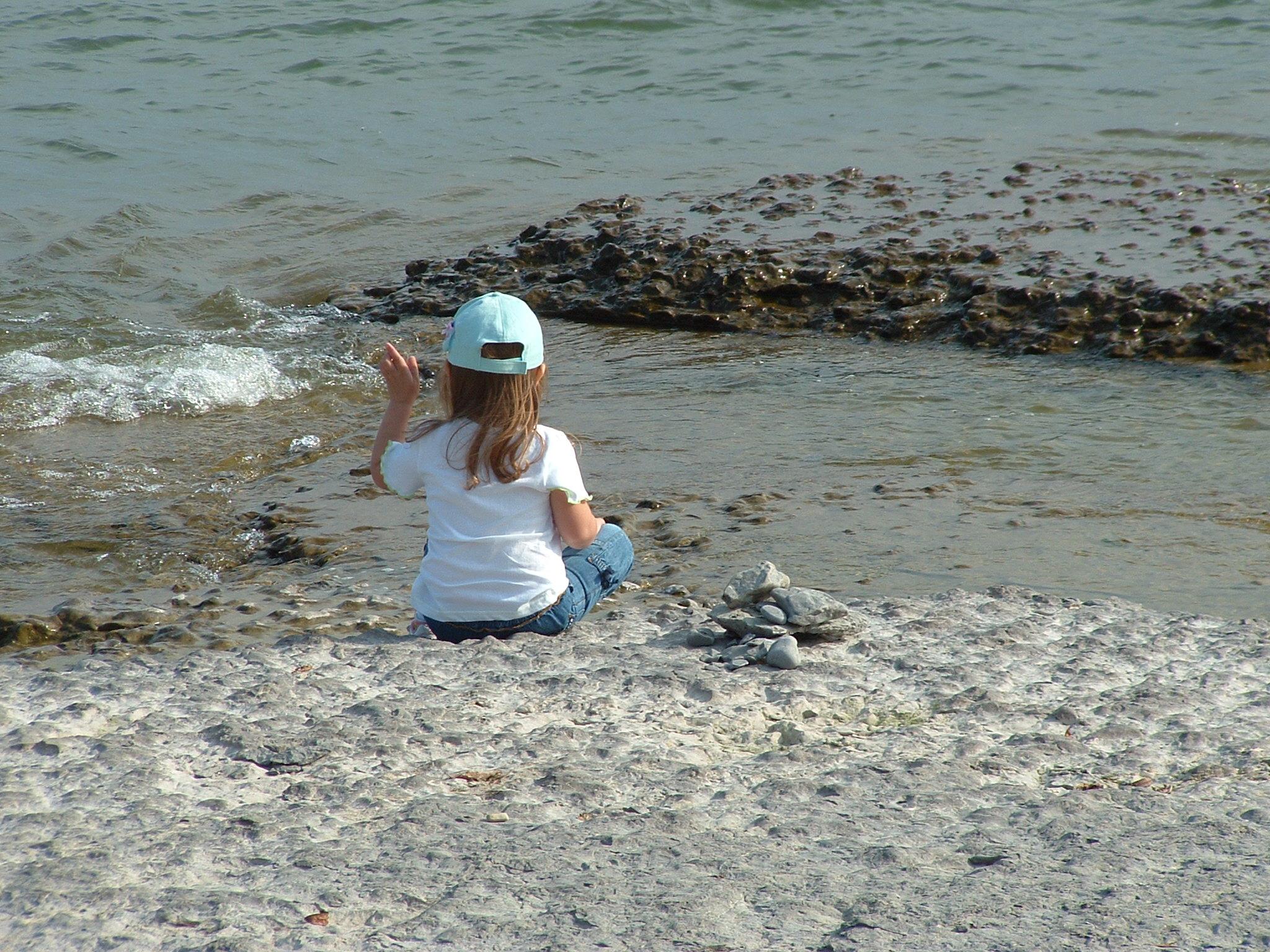 Skipping stones at beach photo