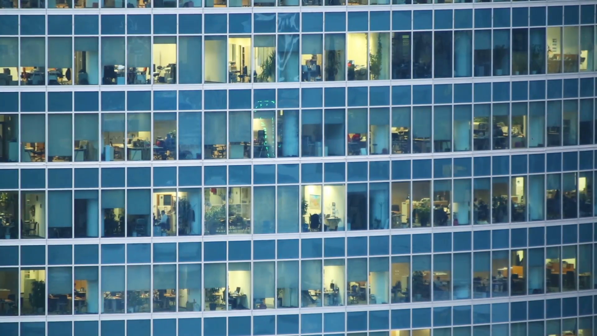 Many people in a windows of modern skyscraper office building Stock ...