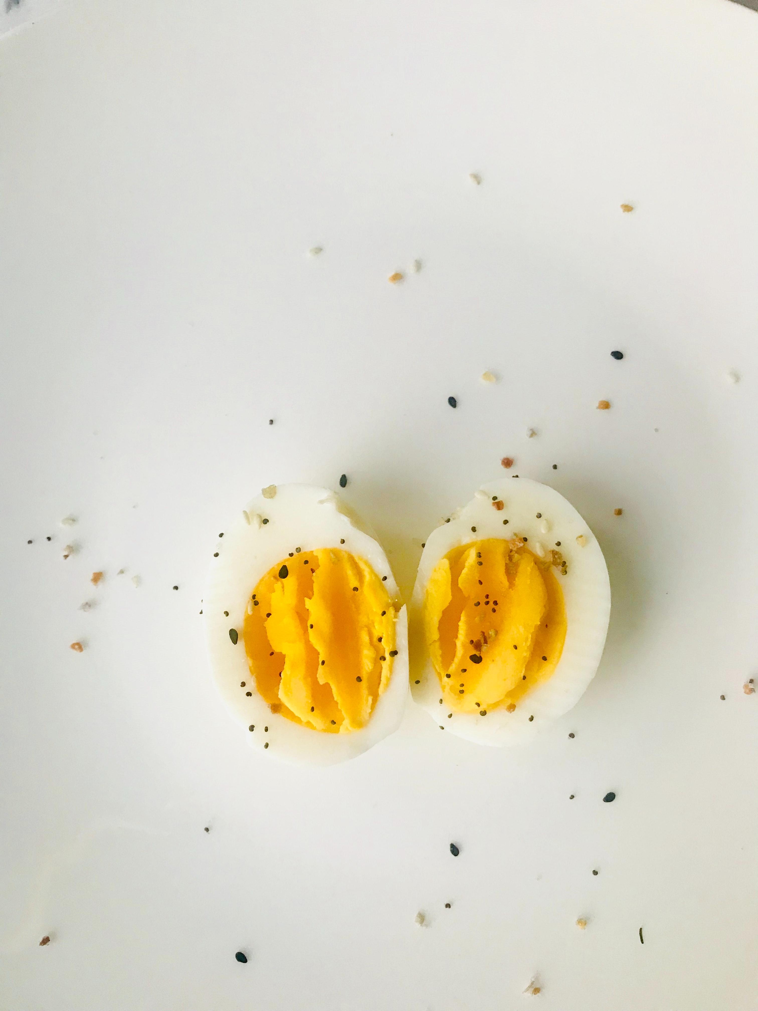 Sliced boiled egg on white plate photo