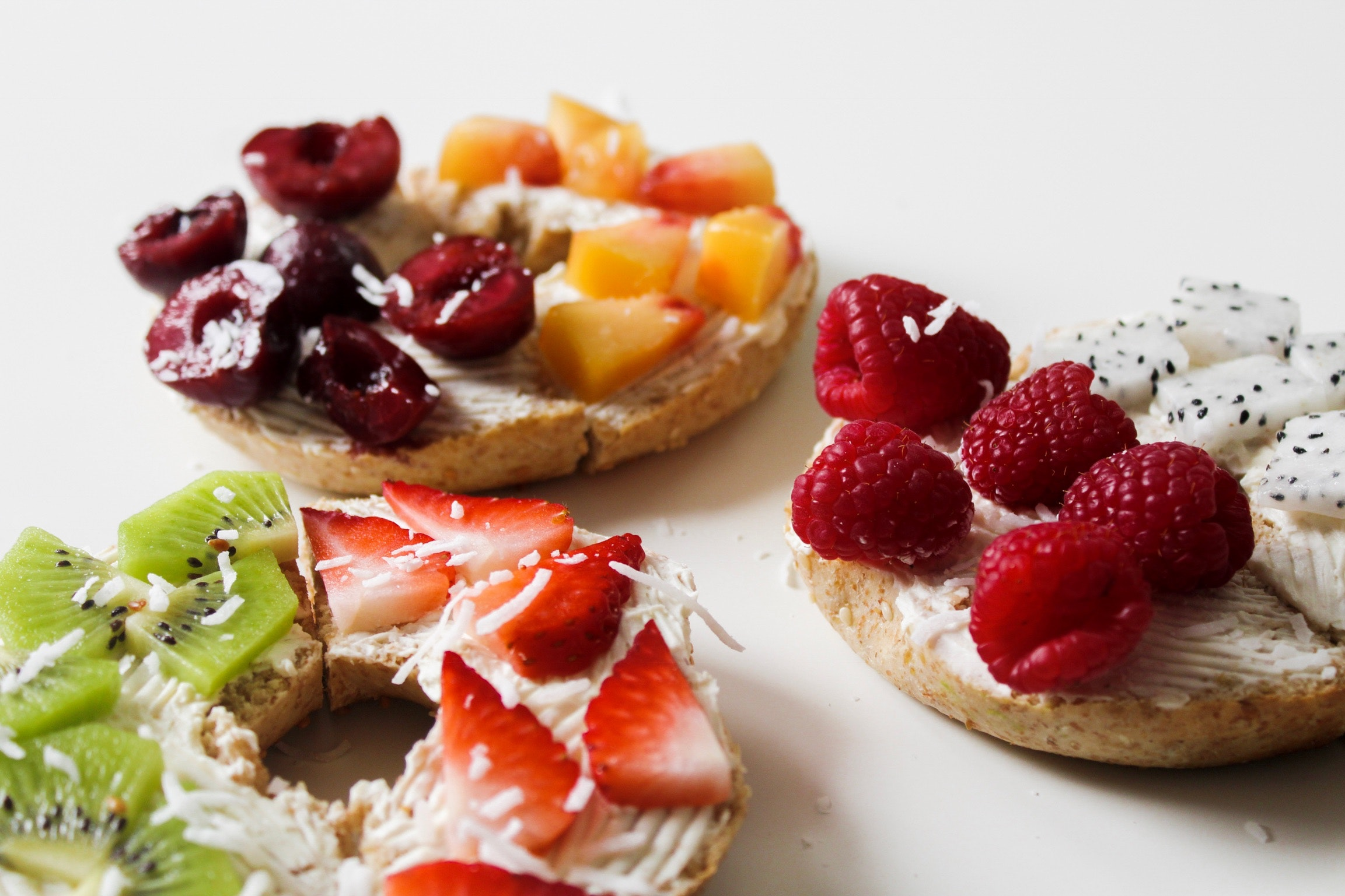 Sliced variety of fruits on round baked bread photo