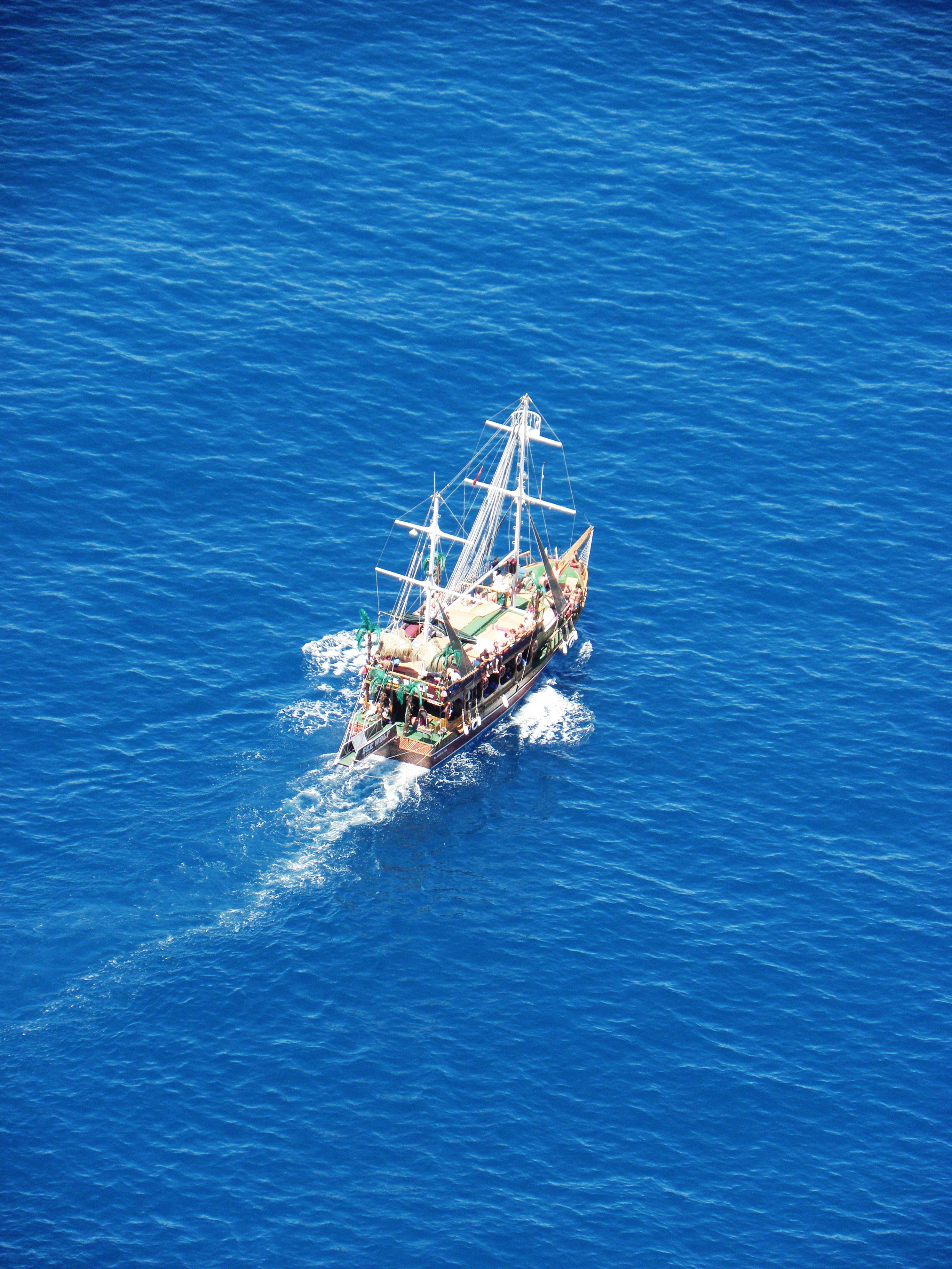 Small ship in the blue waters of mediter photo