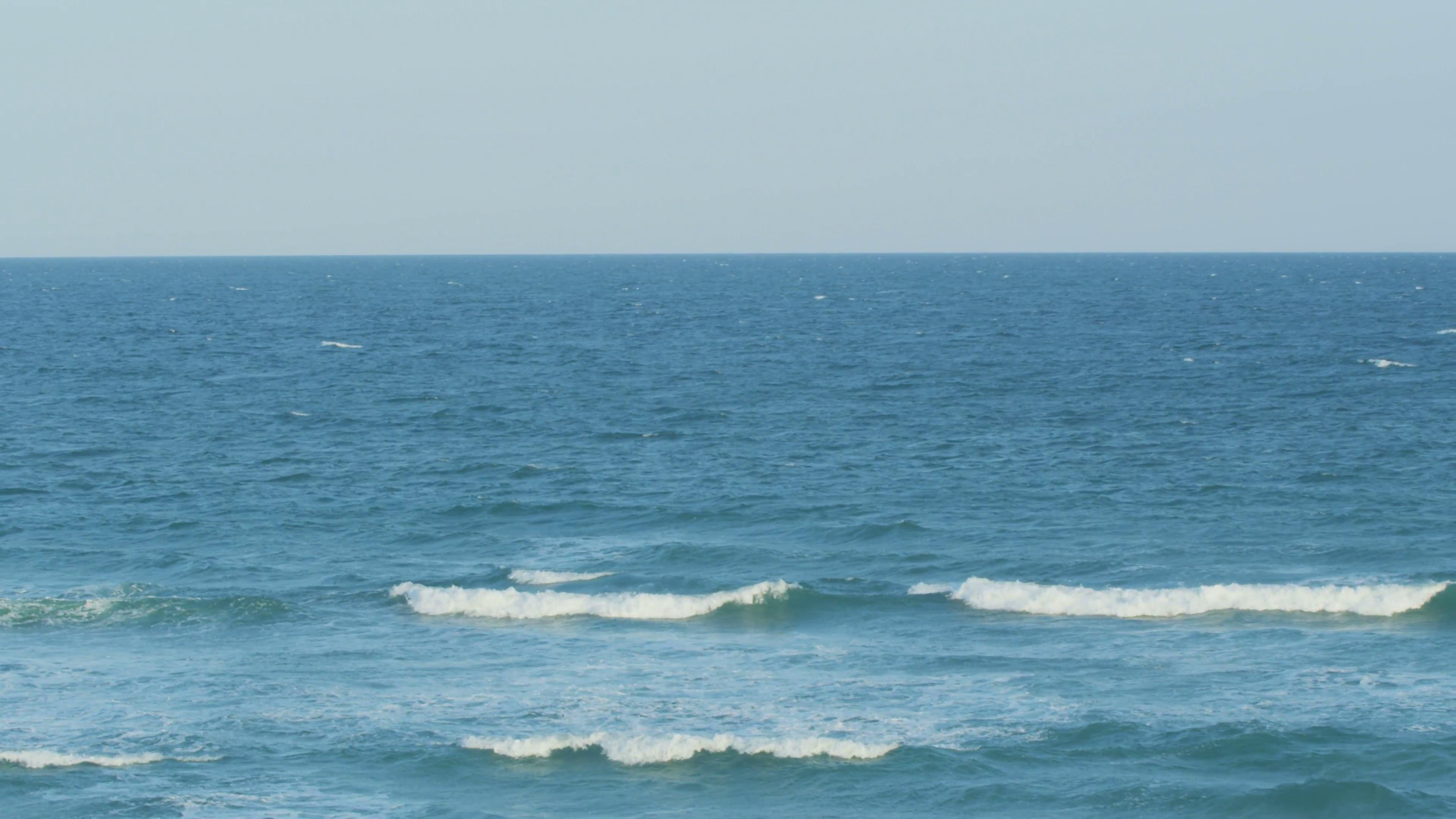 Small waves break on the ocean Stock Video Footage - Videoblocks