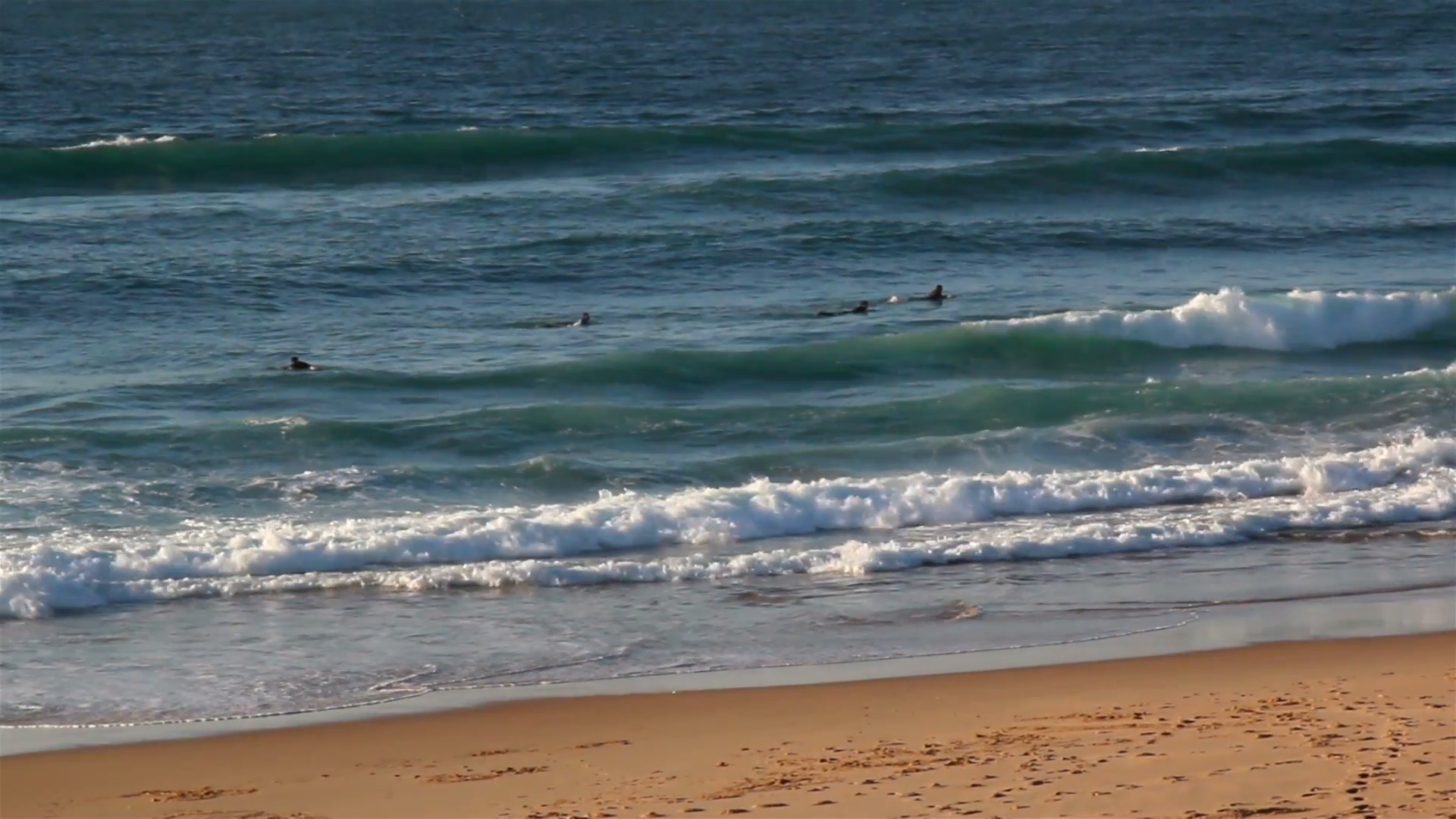 Small waves splashing and approaching the sea shore Stock Video ...