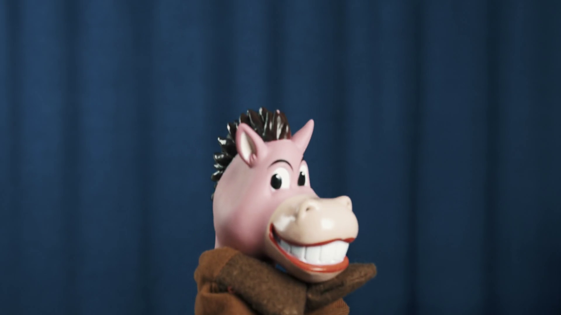 Smiling horse hand puppet toy walks jumping off scene, peeps from ...