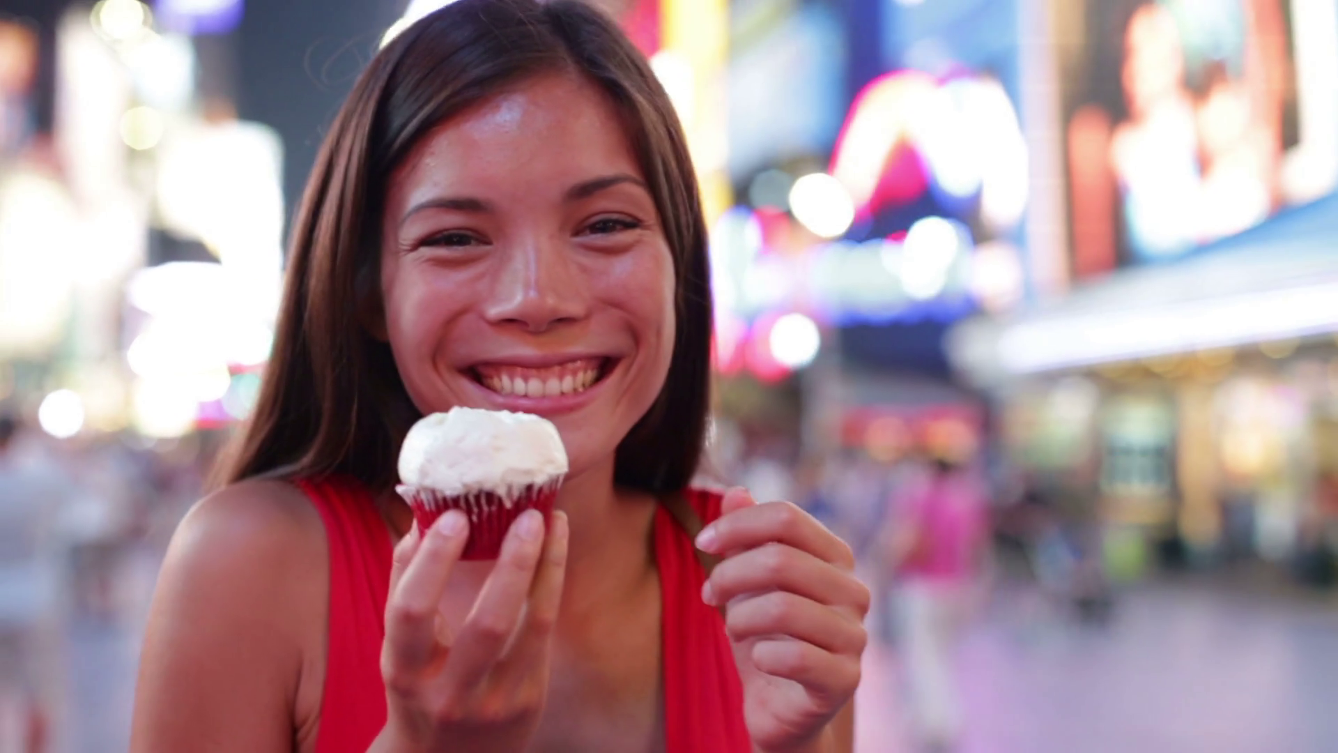 Cupcakes - woman eating cupcake in New York on Times Square ...