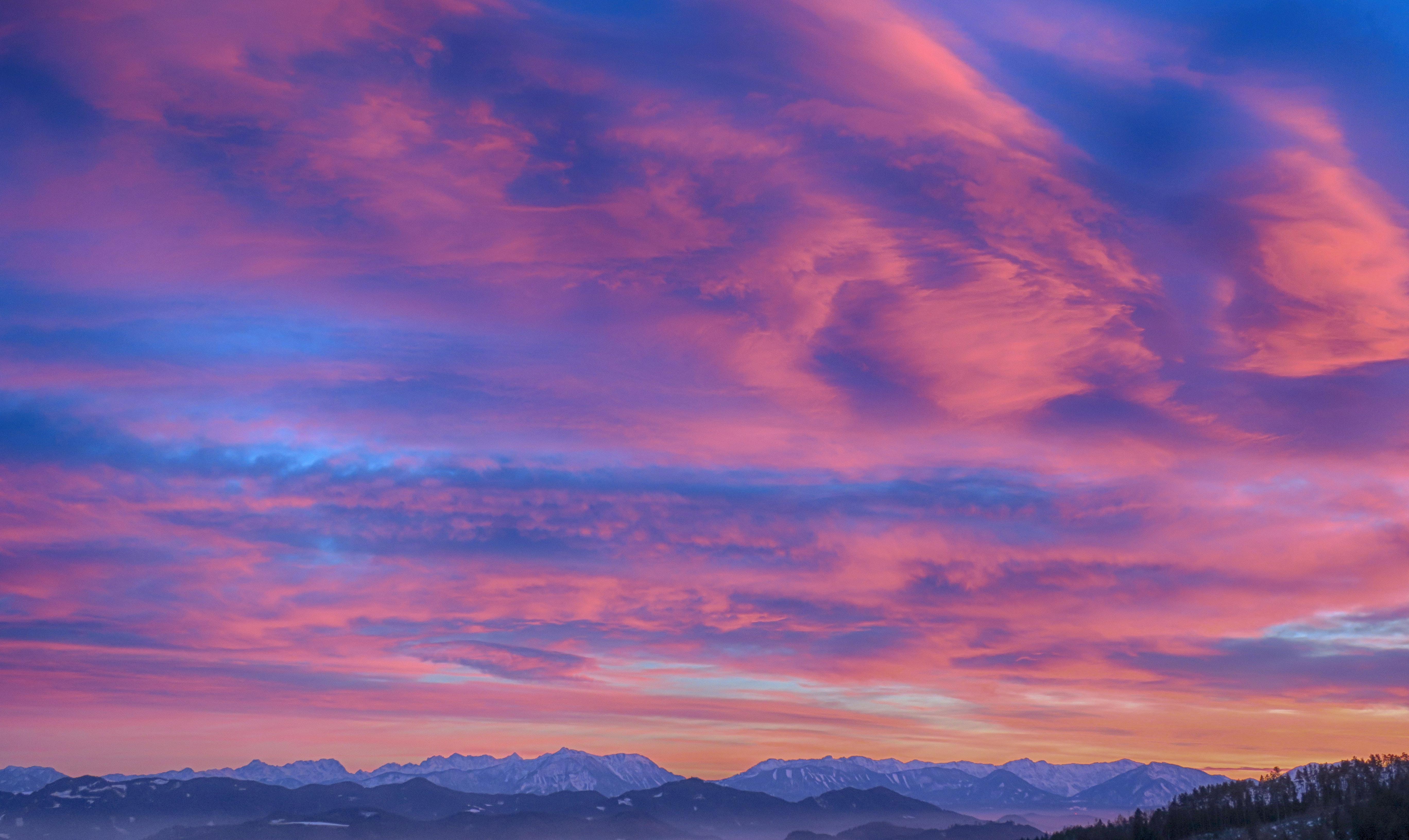 Snow cap mountain under nimbus clouds photo