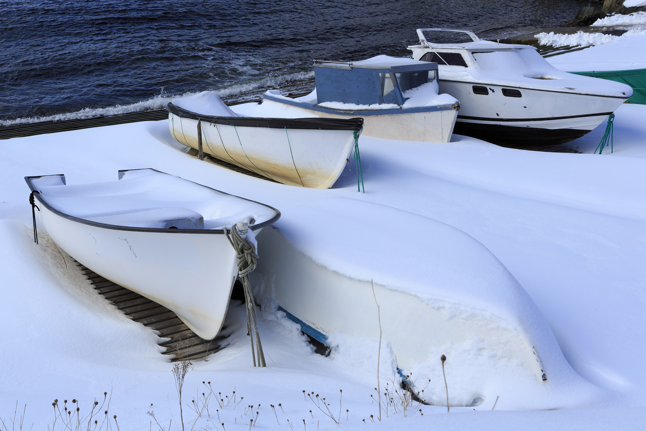 Snow covered fishing boats photo