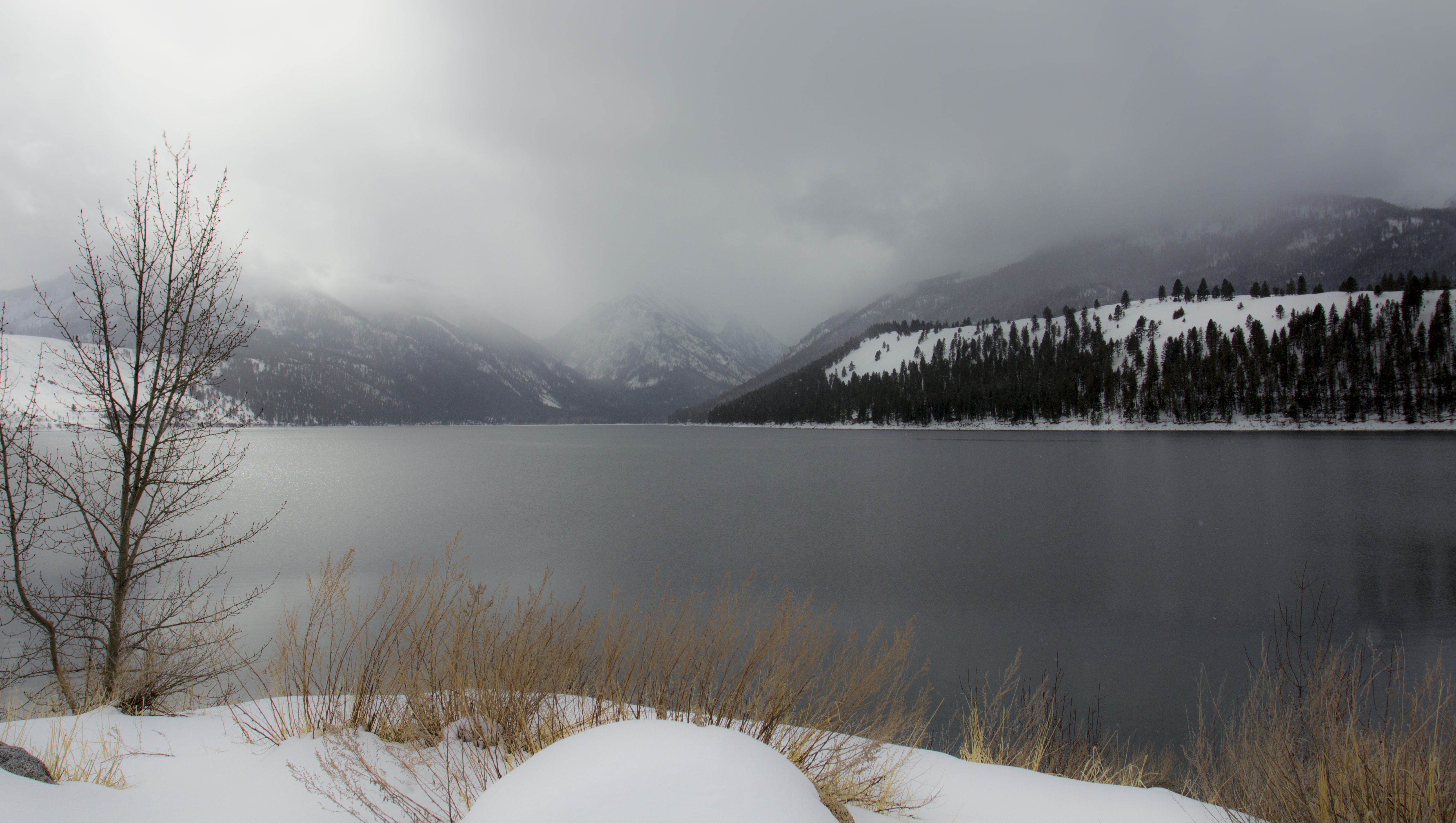 Snow storm moving across wallowa lake, oregon photo
