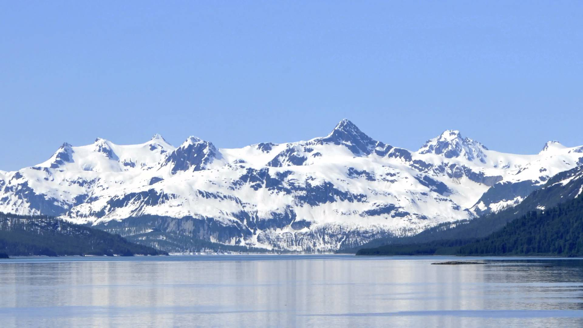 Traveling time-lapse of snow-covered mountains along Glacier Bay ...
