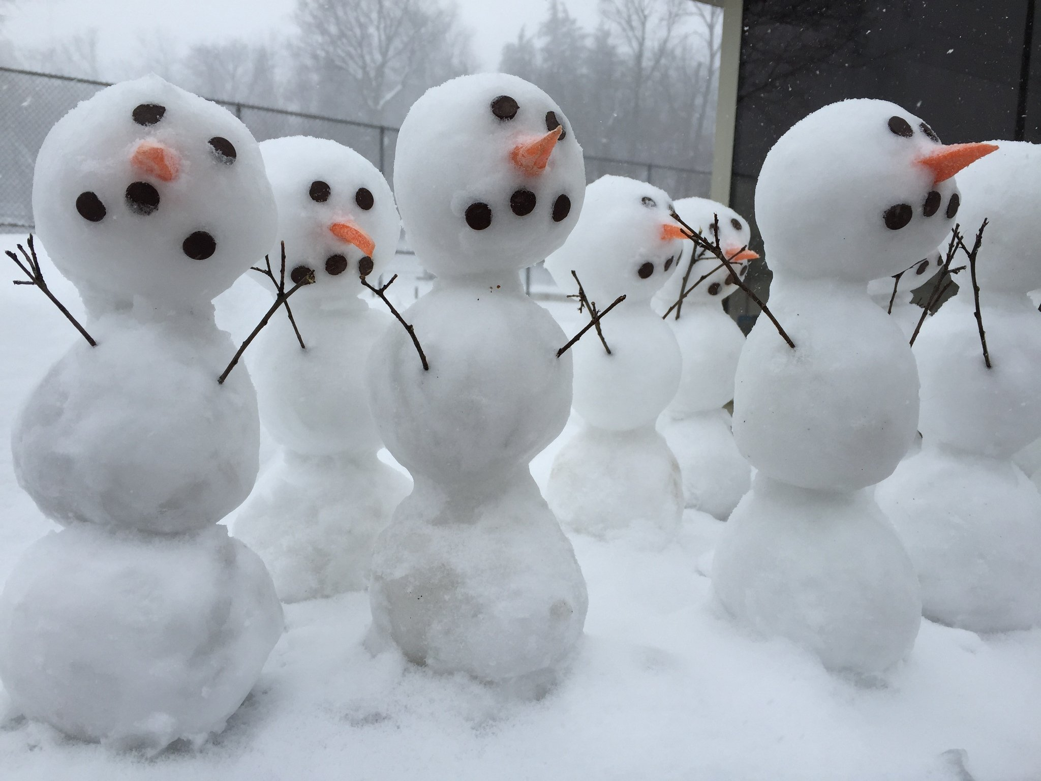 With weather this miserable, even the snowmen are surrendering ...