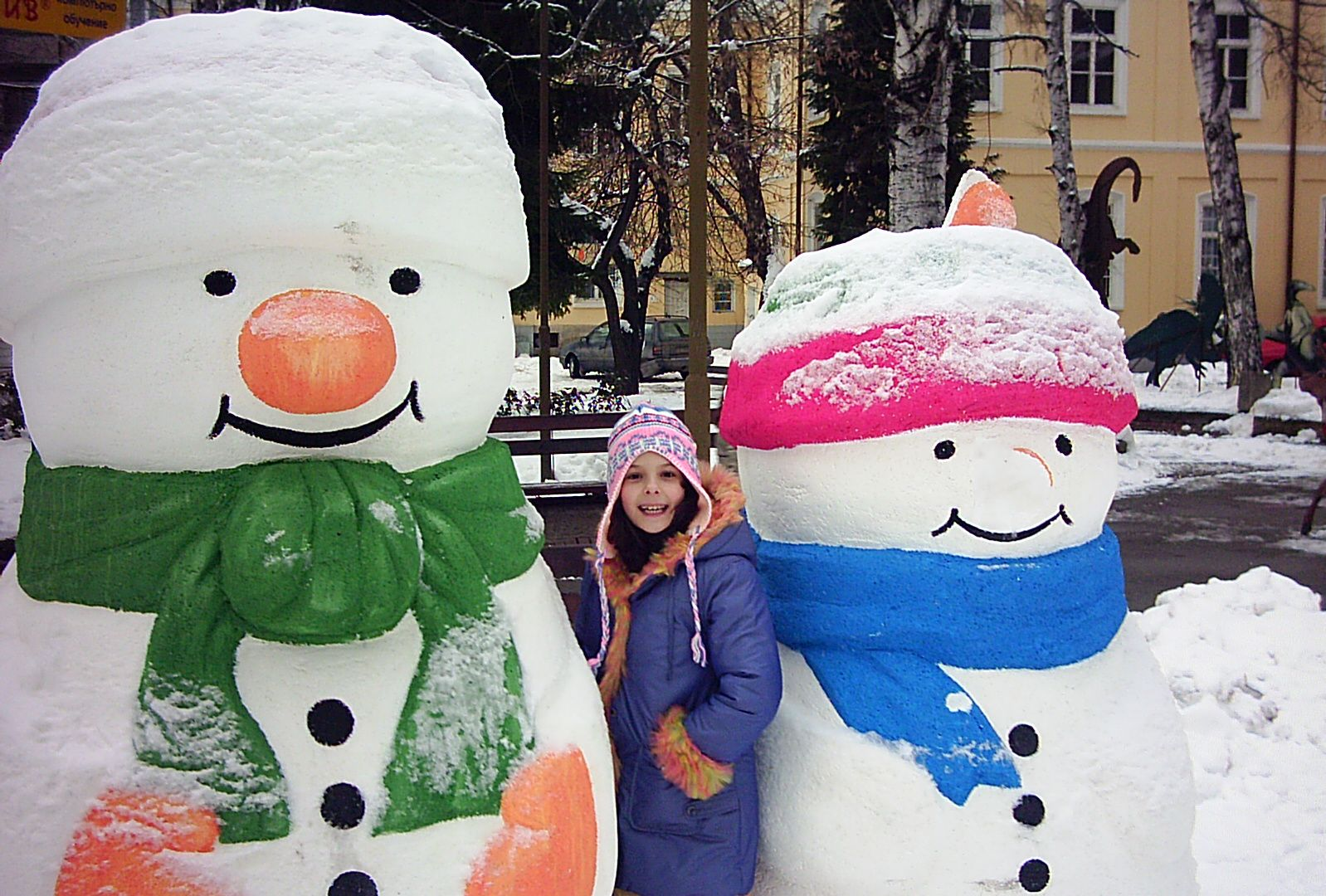 Snowmen and a girl photo