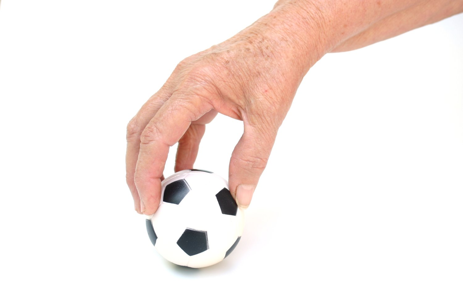 Soccer ball in hand photo